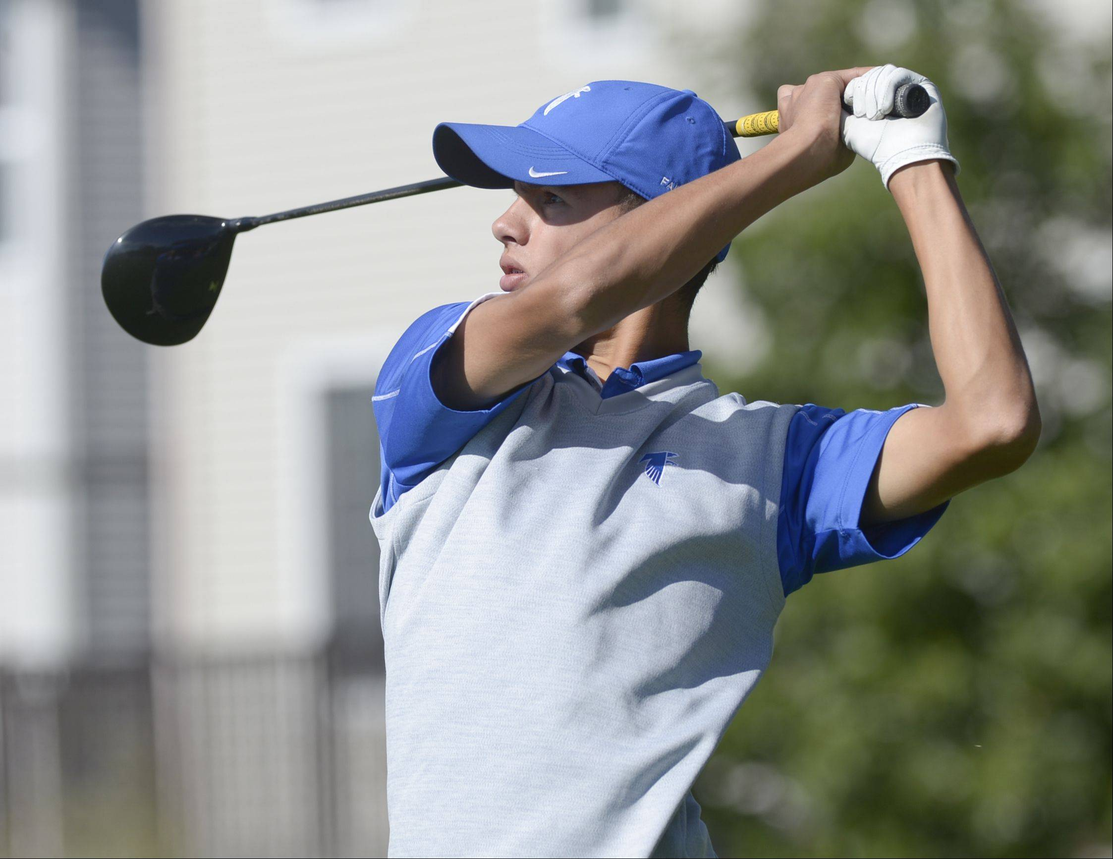 Mark Black/mblack@dailyherald.comCaleb Wiese of Wheaton North tees off during the Class 3A Naperville Central sectional boys golf tournament, Monday at Springbrook Golf Course in Naperville.