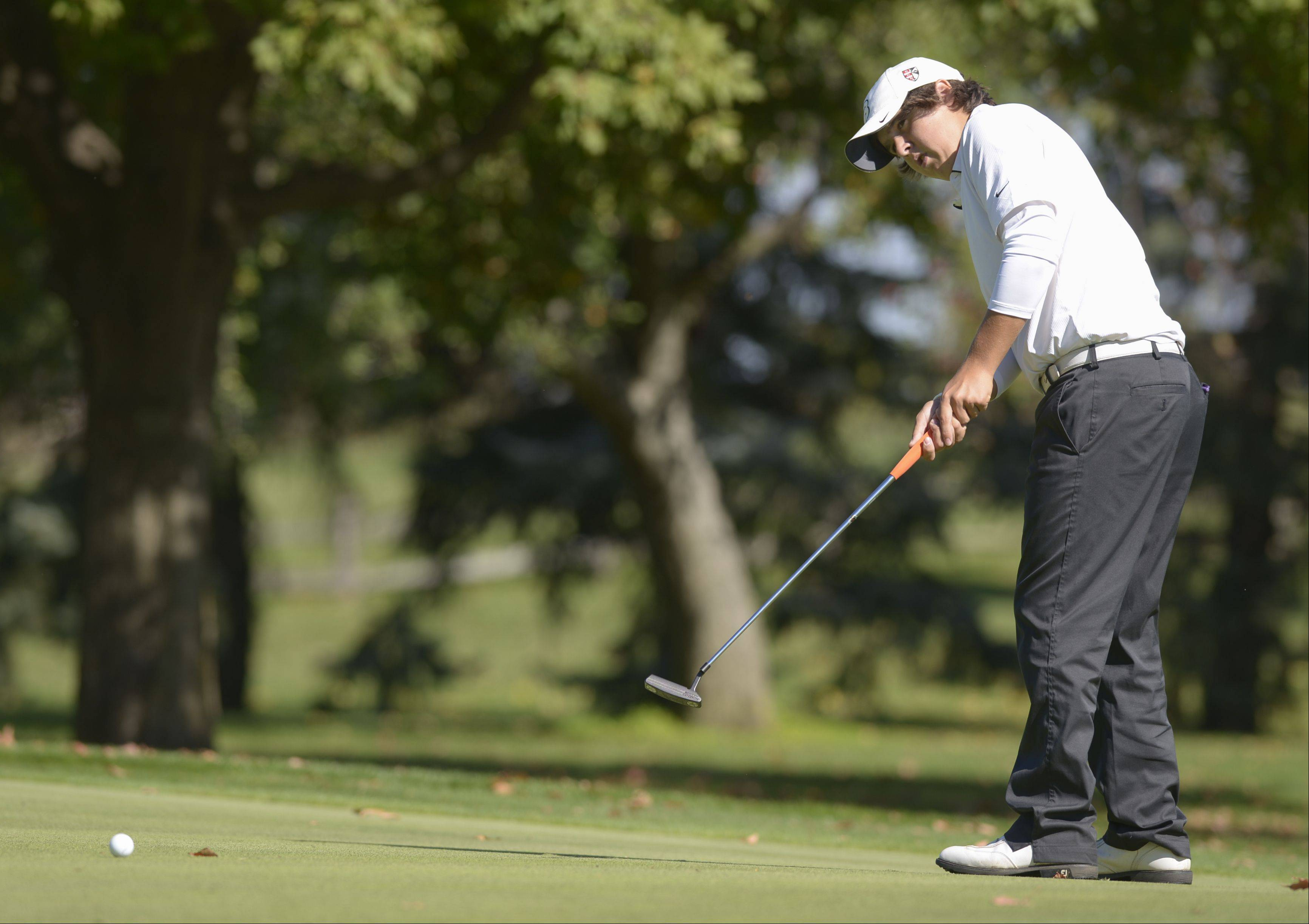 Mark Black/mblack@dailyherald.comWill Denman of Wheaton Warrenville South putts during the Class 3A Naperville Central sectional boys golf tournament, Monday at Springbrook Golf Course in Naperville.