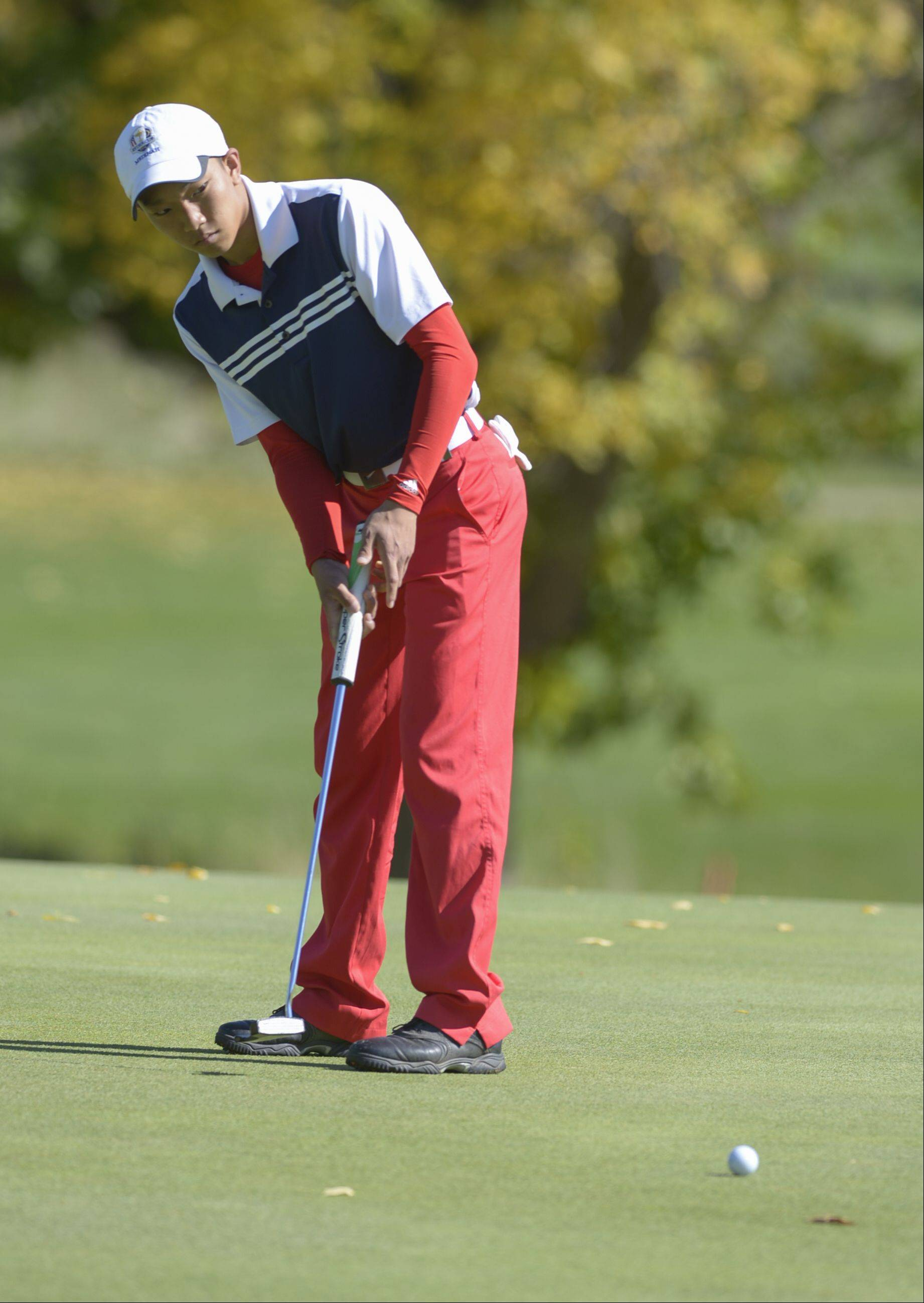Mark Black/mblack@dailyherald.comJon Chang of Conant putts during the Class 3A Naperville Central sectional boys golf tournament, Monday at Springbrook Golf Course in Naperville.