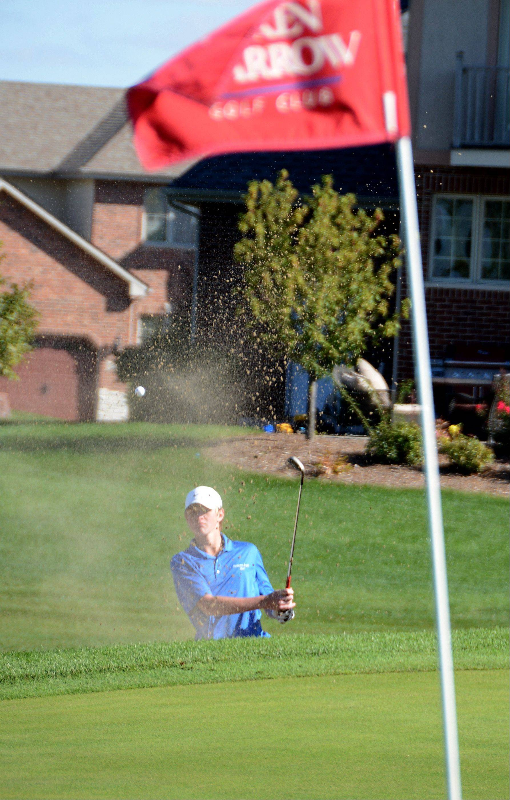 Glenbard South's Russell Matos shoots out the sand on the first hole. Class 2A boys golf sectional Monday at Broken Arrow Golf Course in Lockport.