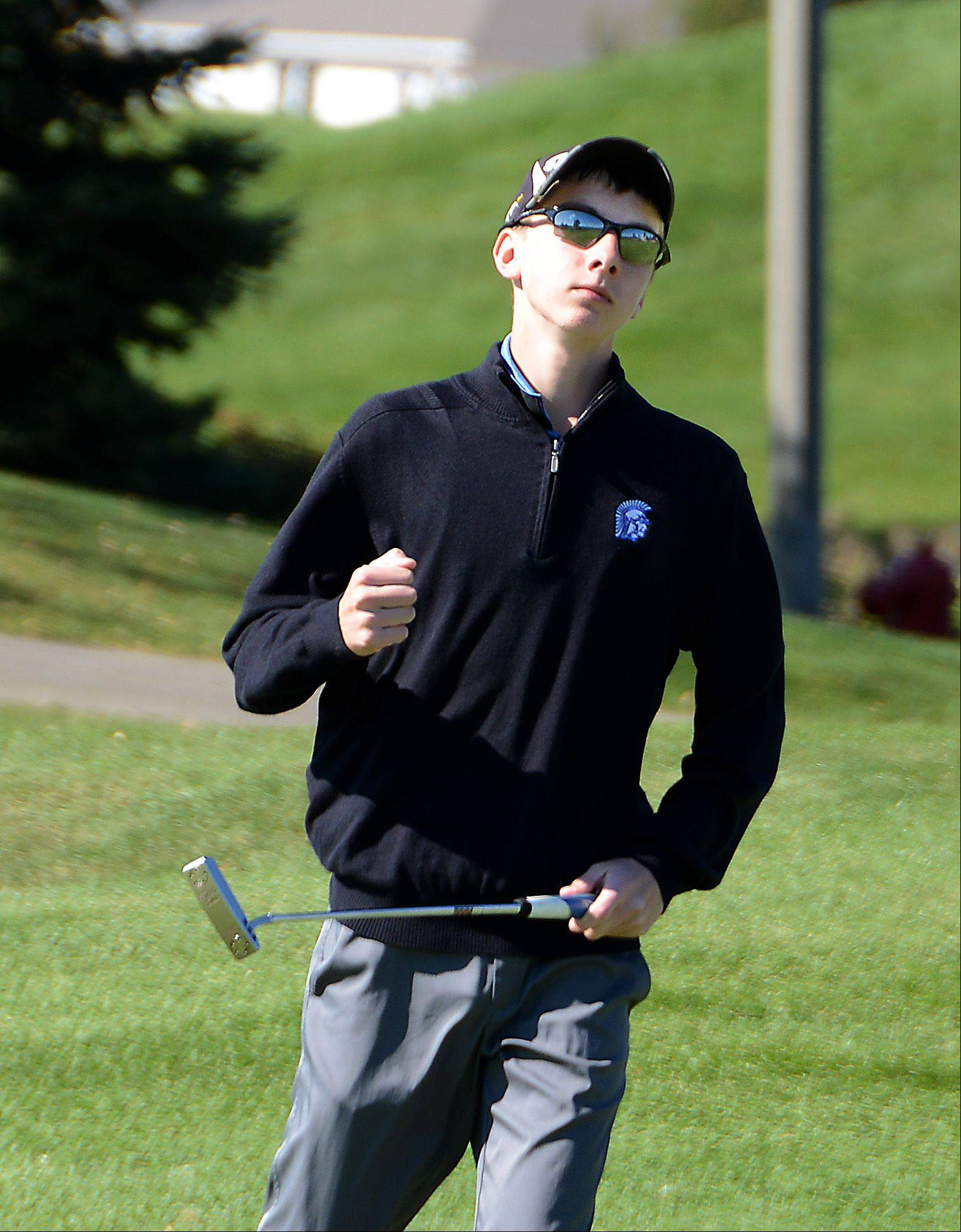 St. Francis' Connor Buckley pumps his fist after sinking a 30' put on the ninth hole. Class 2A boys golf sectional Monday at Broken Arrow Golf Course in Lockport.
