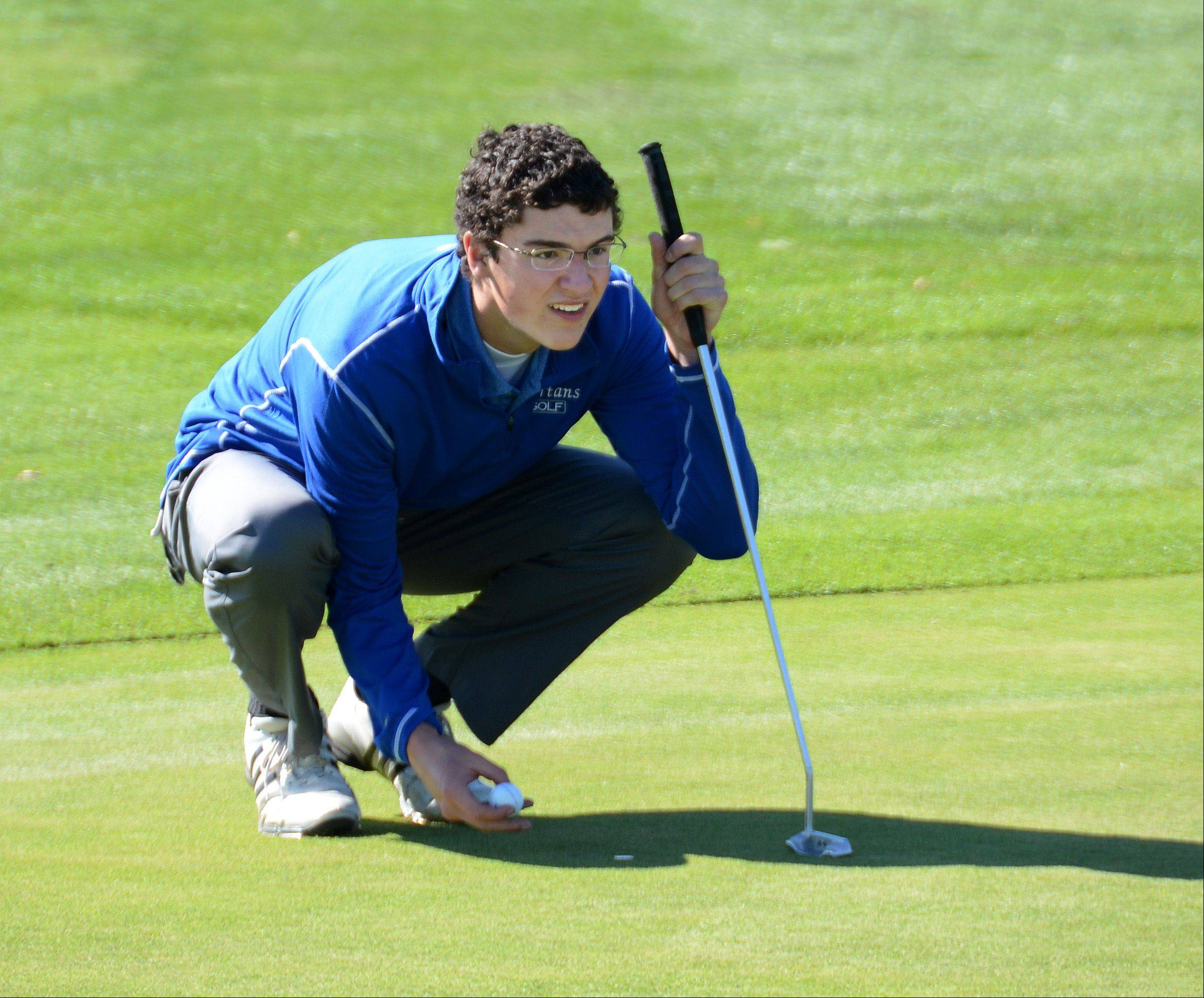 St. Francis' Dan Zurawski lines up a put on the ninth hole. Class 2A boys golf sectional Monday at Broken Arrow Golf Course in Lockport.