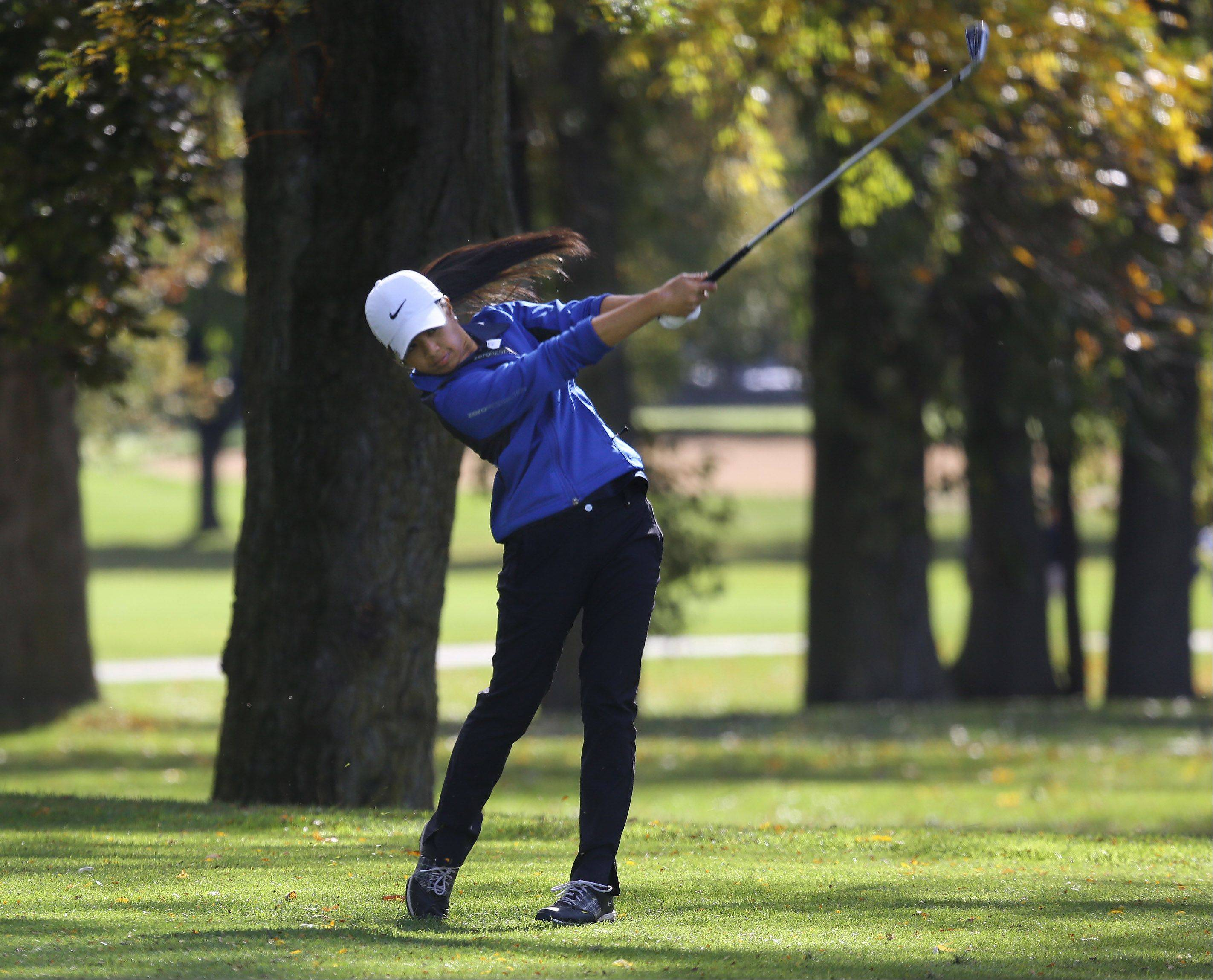 Gilbert R. Boucher II/gboucher@dailyherald.comBuffalo Grove golfer Amber Guiao tees off on the 4th hole during the Buffalo Grove sectional Monday at the Buffalo Grove Golf Course.