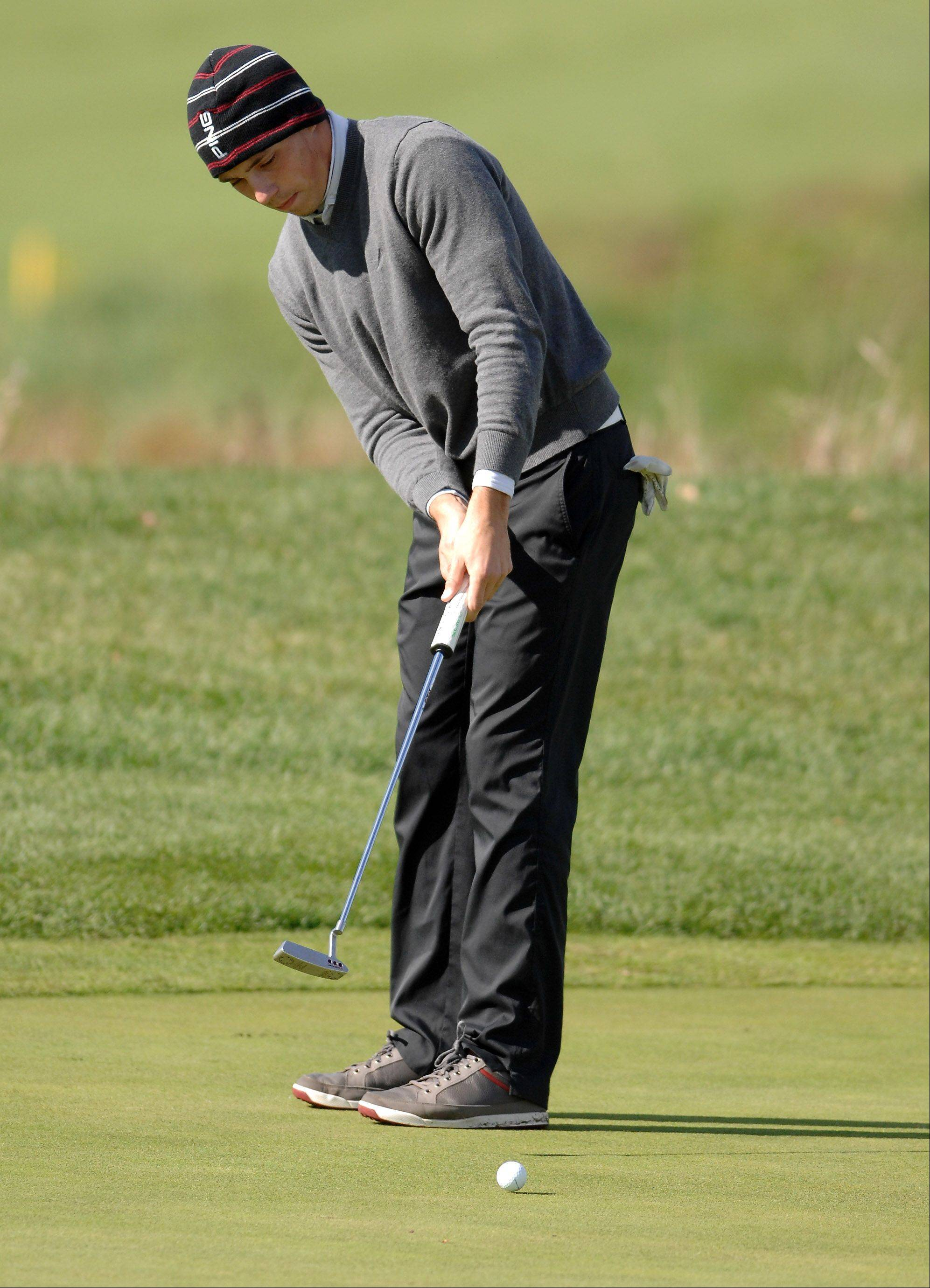 Jackson Wietecha of Carmel sinks a putt during the Huntley boys golf sectional at Blackstone Golf Club in Marengo.