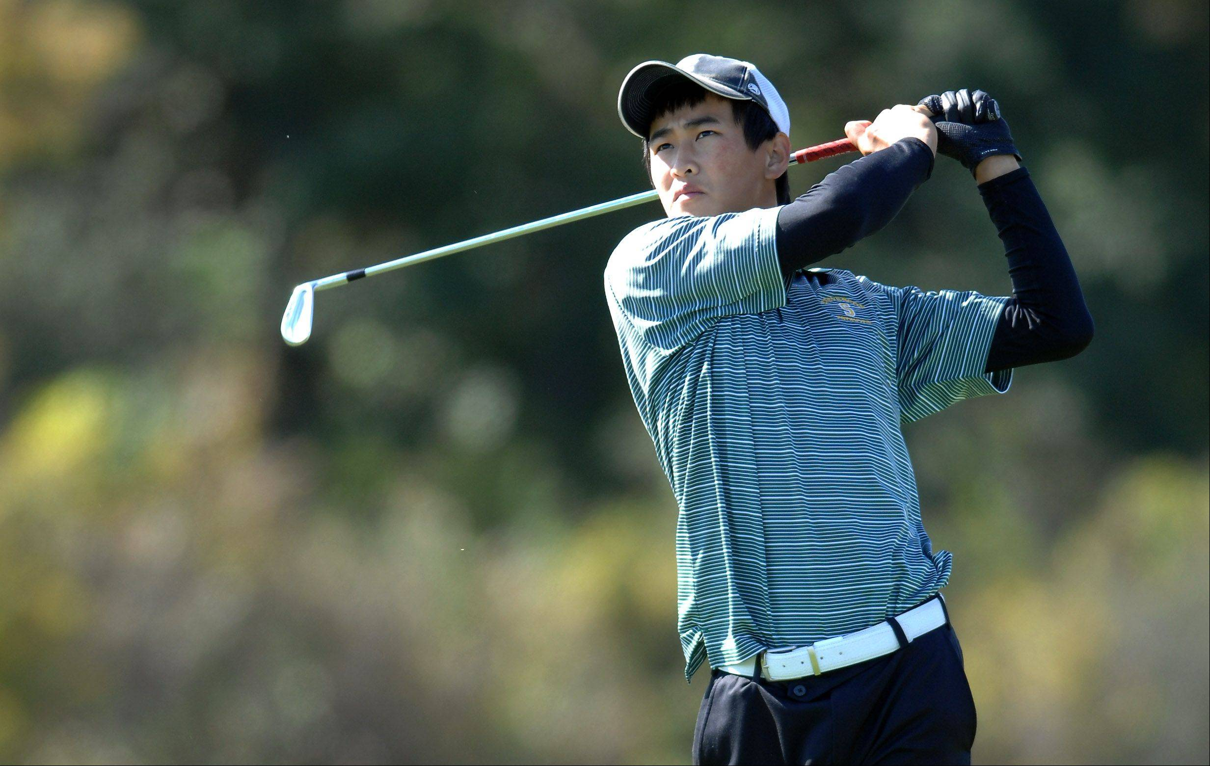 Jerry Pan of Stevenson hits during the Huntley boys golf sectional at Blackstone Golf Club in Marengo.