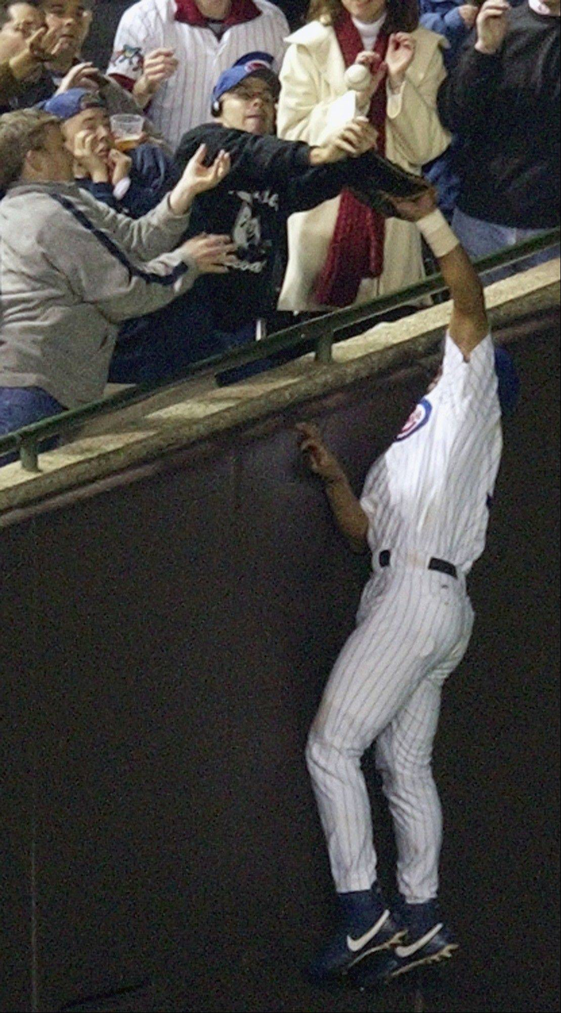Moises Alou and Steve Bartman became a part of Cubs history on Oct. 14, 2003, in Game 6 of the National League championship series at Wrigley Field.