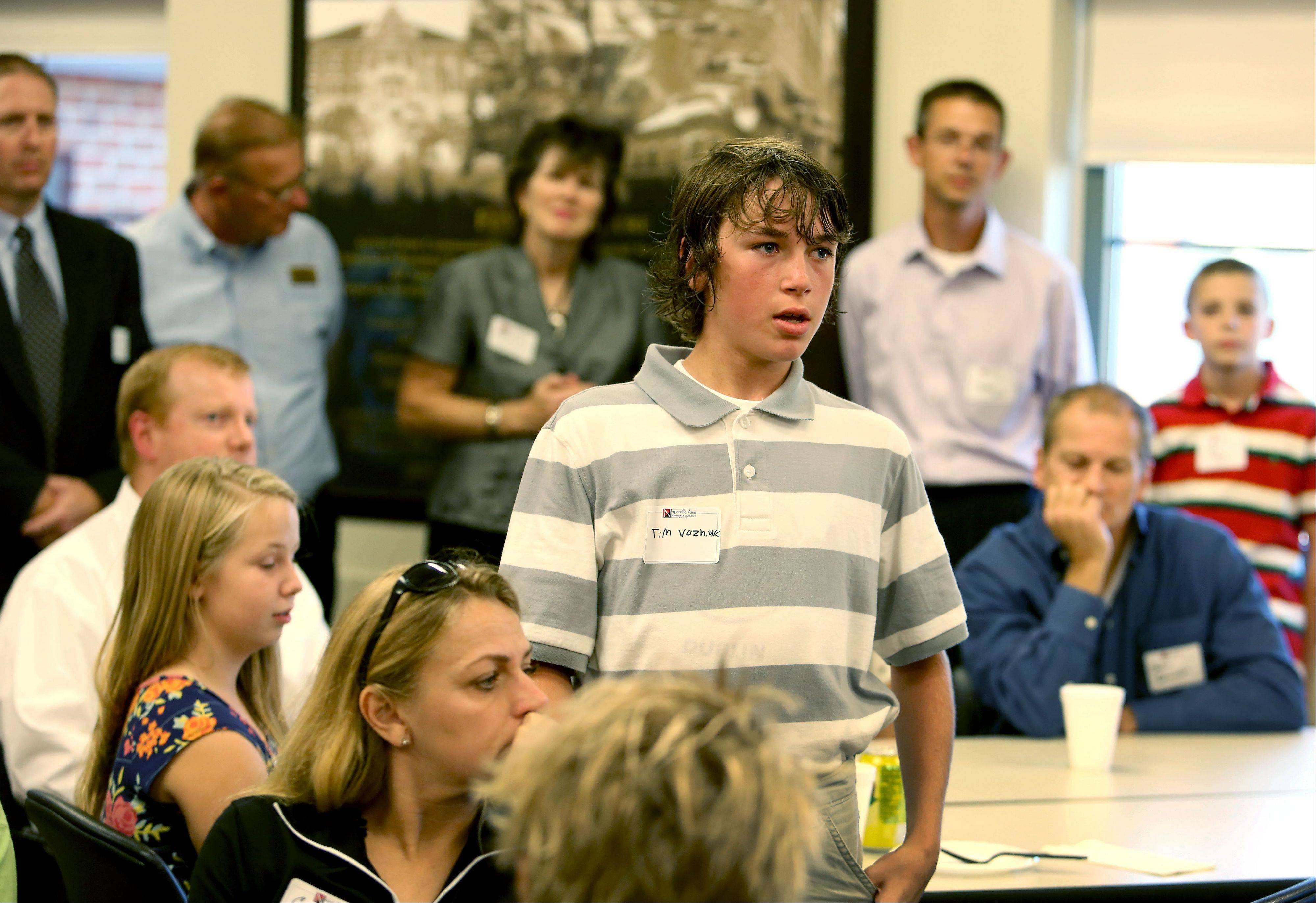 Tim Wozniak, an eighth-grader at Jefferson Junior High School in Naperville, introduces his business idea � a gym offering fitness through obstacle courses and dodgeball � during a meet and greet the Naperville Area Chamber of Commerce sponsored for participants in its first class of the Young Entrepreneurs Academy.