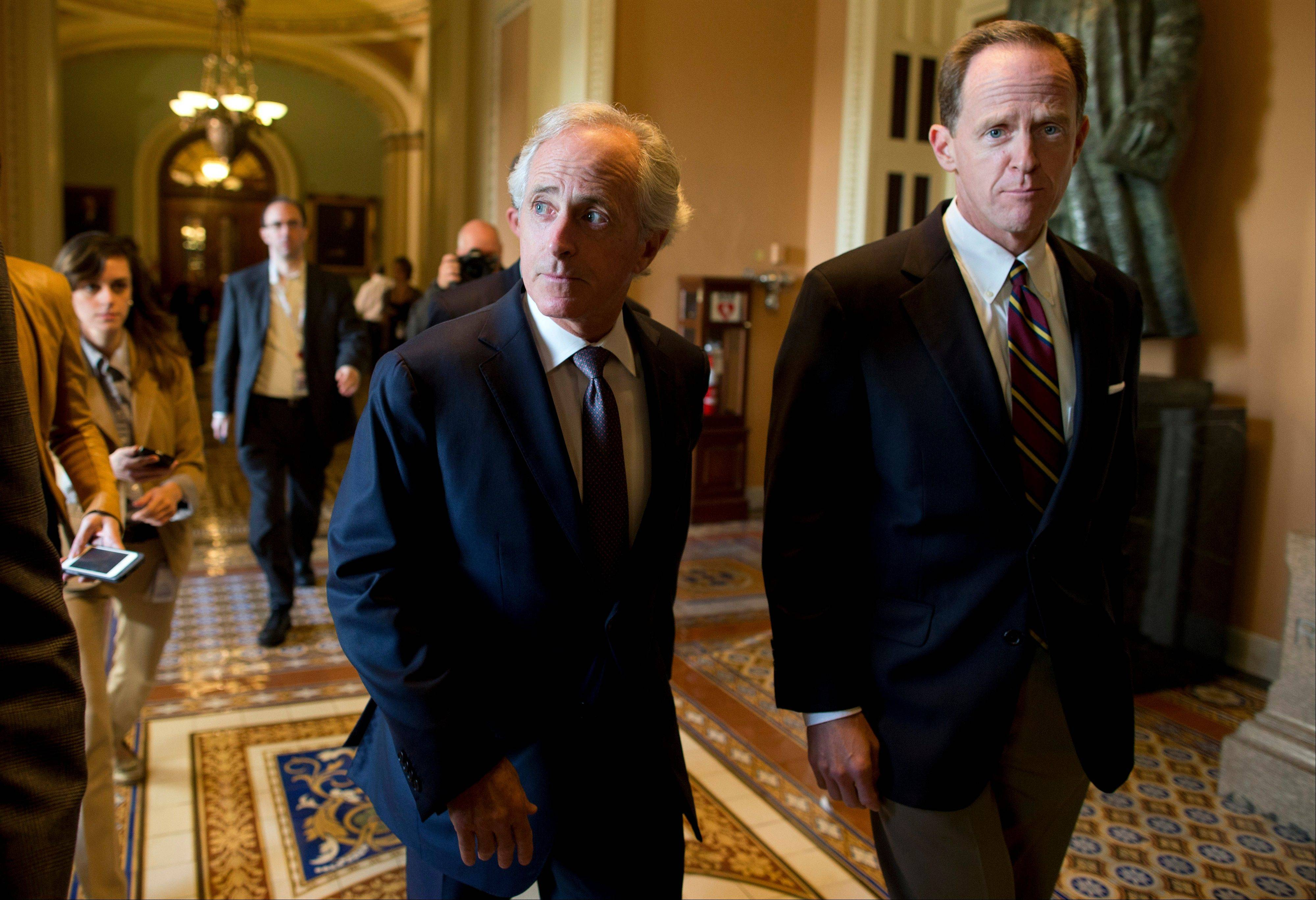 Sen. Bob Corker, R-Tenn., left, walks with Sen. Patrick Toomey, R-Pa., to a meeting with Senate Minority Leader Sen. Mitch McConnell, R-Ky., on Capitol Hill on Monday.