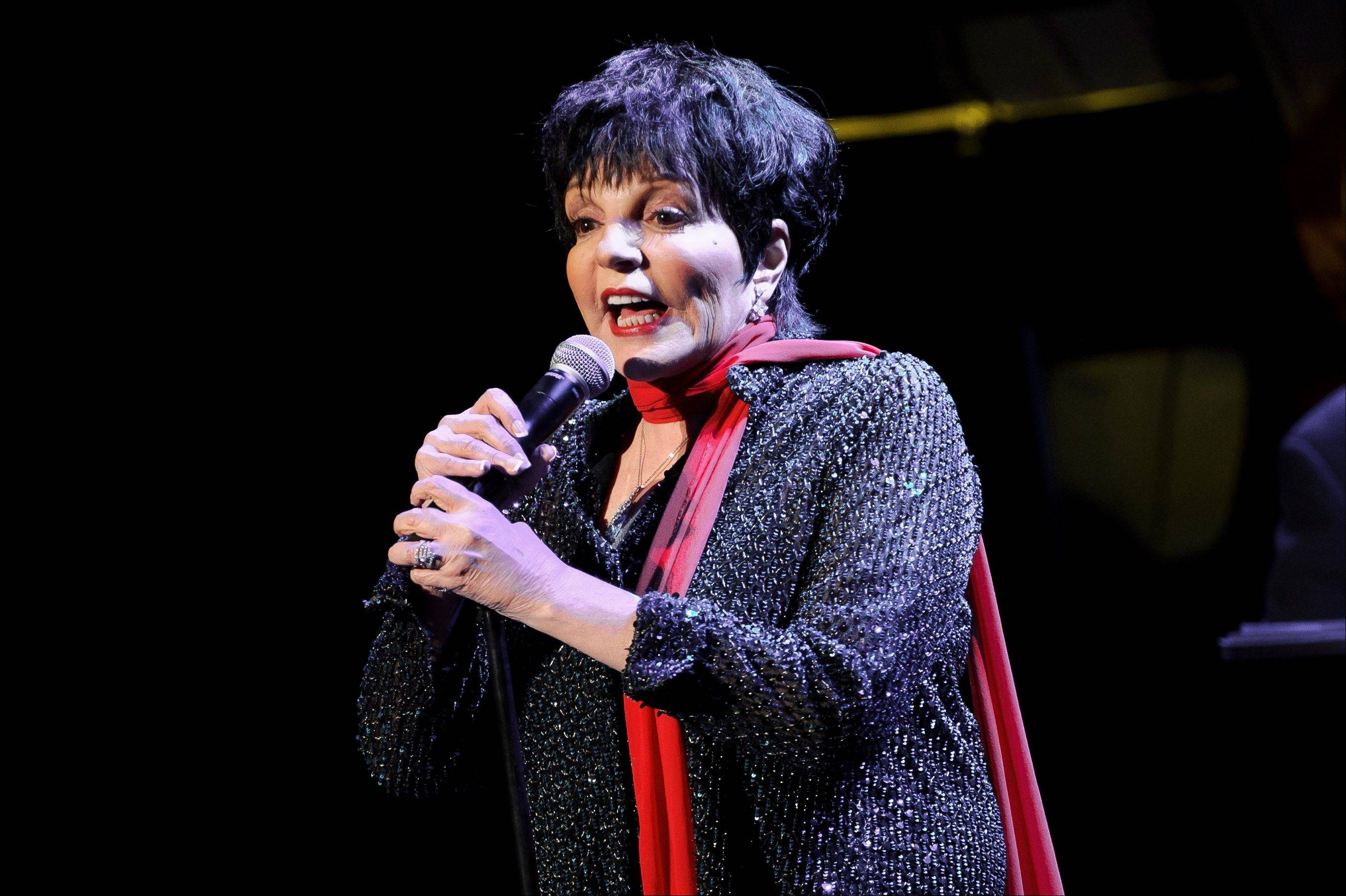 Liza Minnelli performed with a broken wrist at a benefit concert Monday night, Oct. 14, 2013, in New York. Minnelli broke her wrist in three places while rehearsing at home Sunday night.