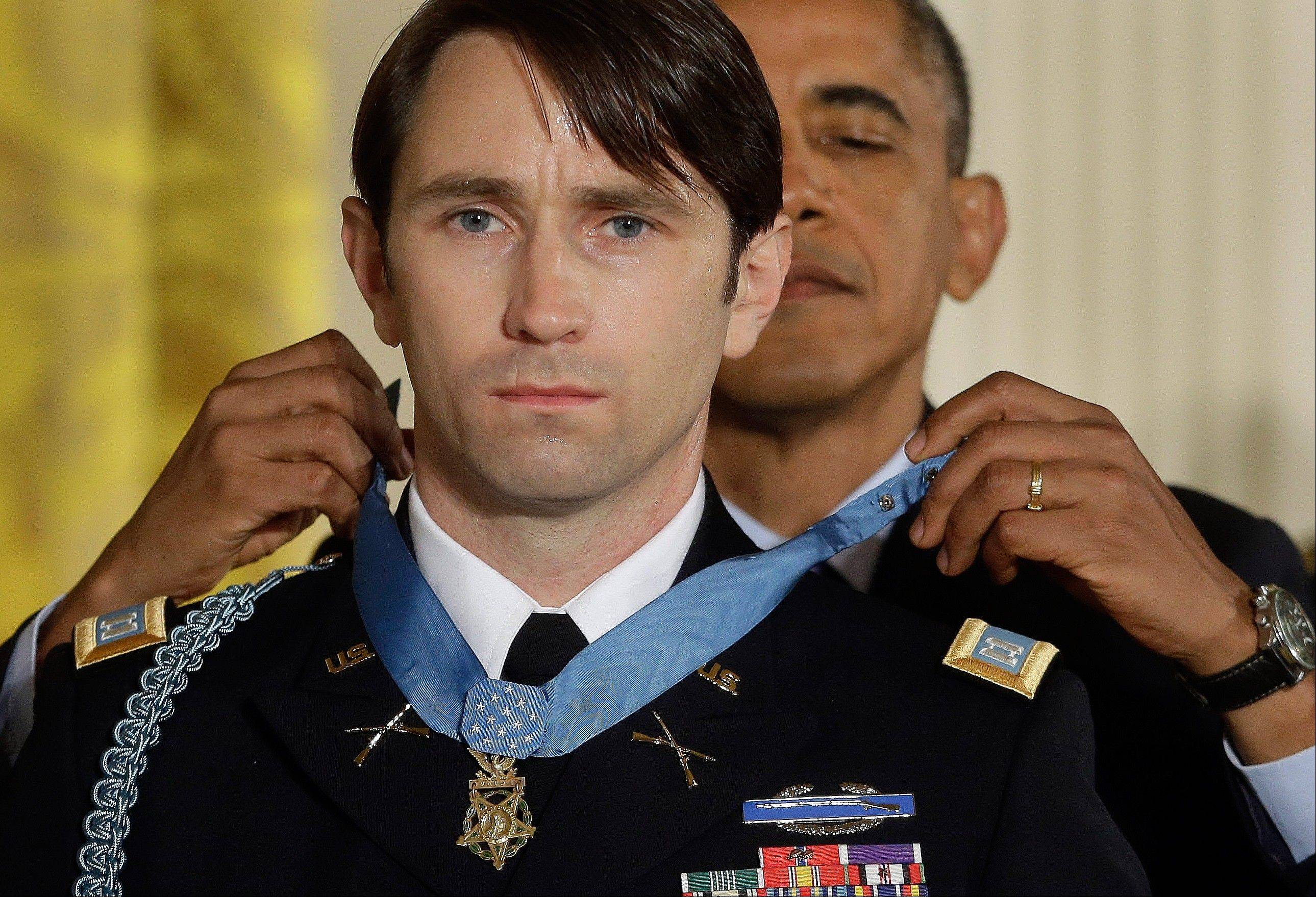 President Barack Obama awards the Medal of Honor to former Army Capt. William D. Swenson of Seattle during a ceremony at the White House Tuesday. Swenson was awarded for his actions in a lengthy battle against Taliban insurgents in Afghanistan in 2009, which claimed the lives of five Americans, 10 Afghan army troops and an interpreter.