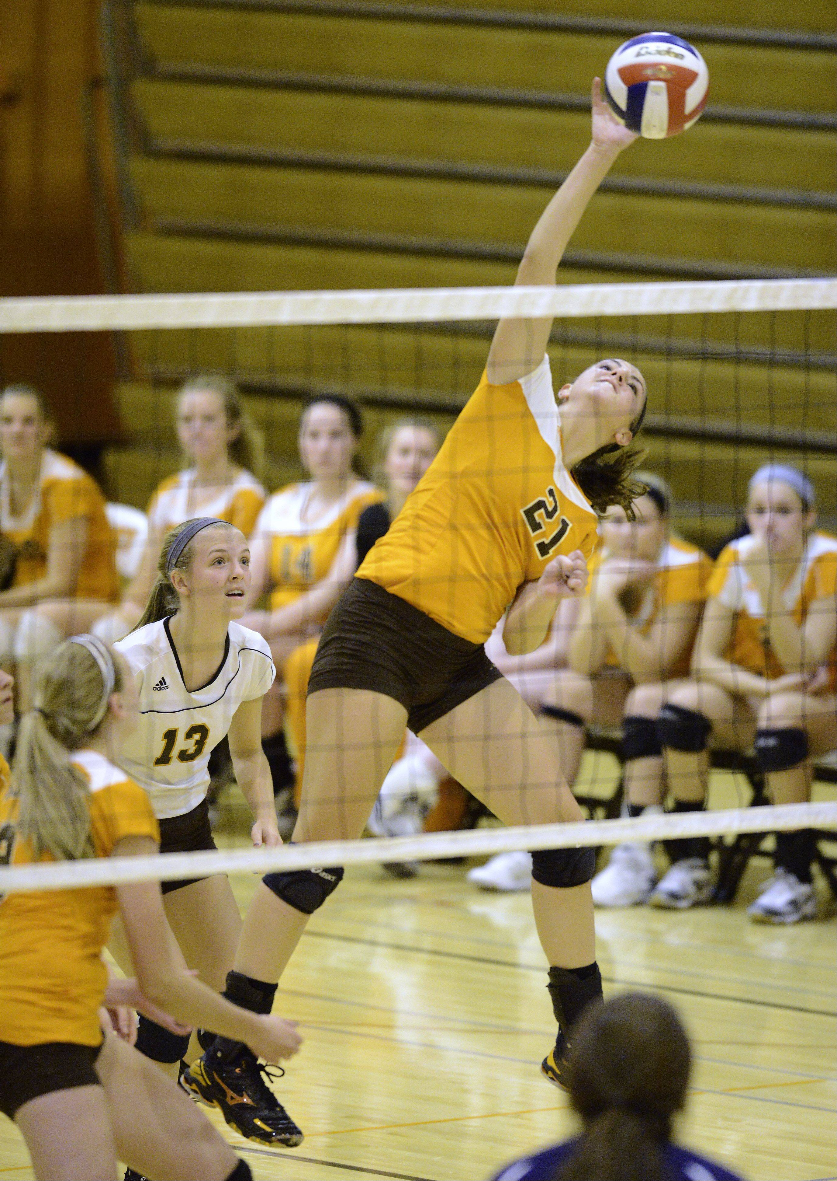 Hersey�s Courtney Stedman leaps for a kill during Tuesday�s MSL East-clinching match against Buffalo Grove.