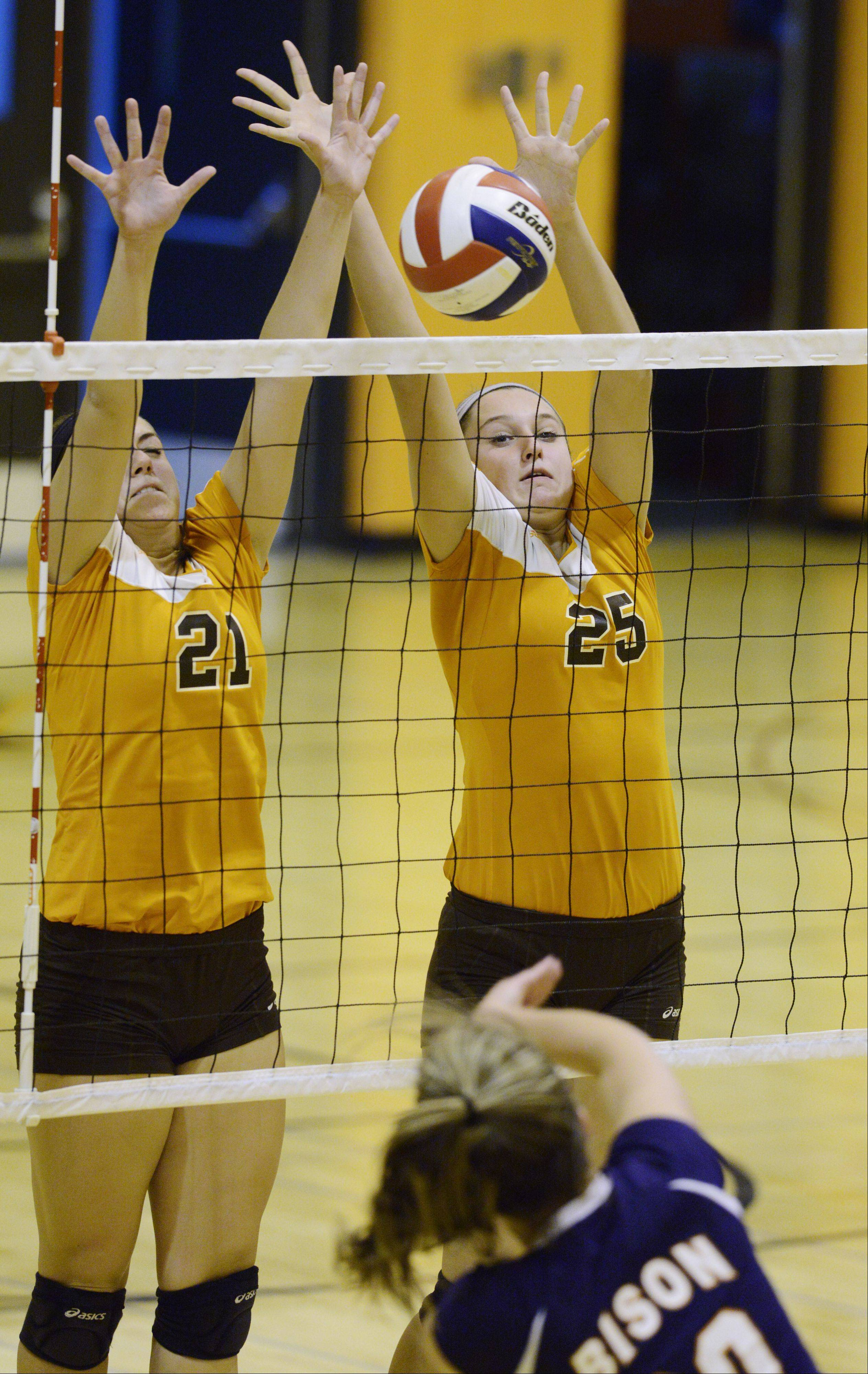 Hersey�s Courtney Stedman, left, and Gabri Olhava block a ball at the net hit by Buffalo Grove�s Alaina Murphy.