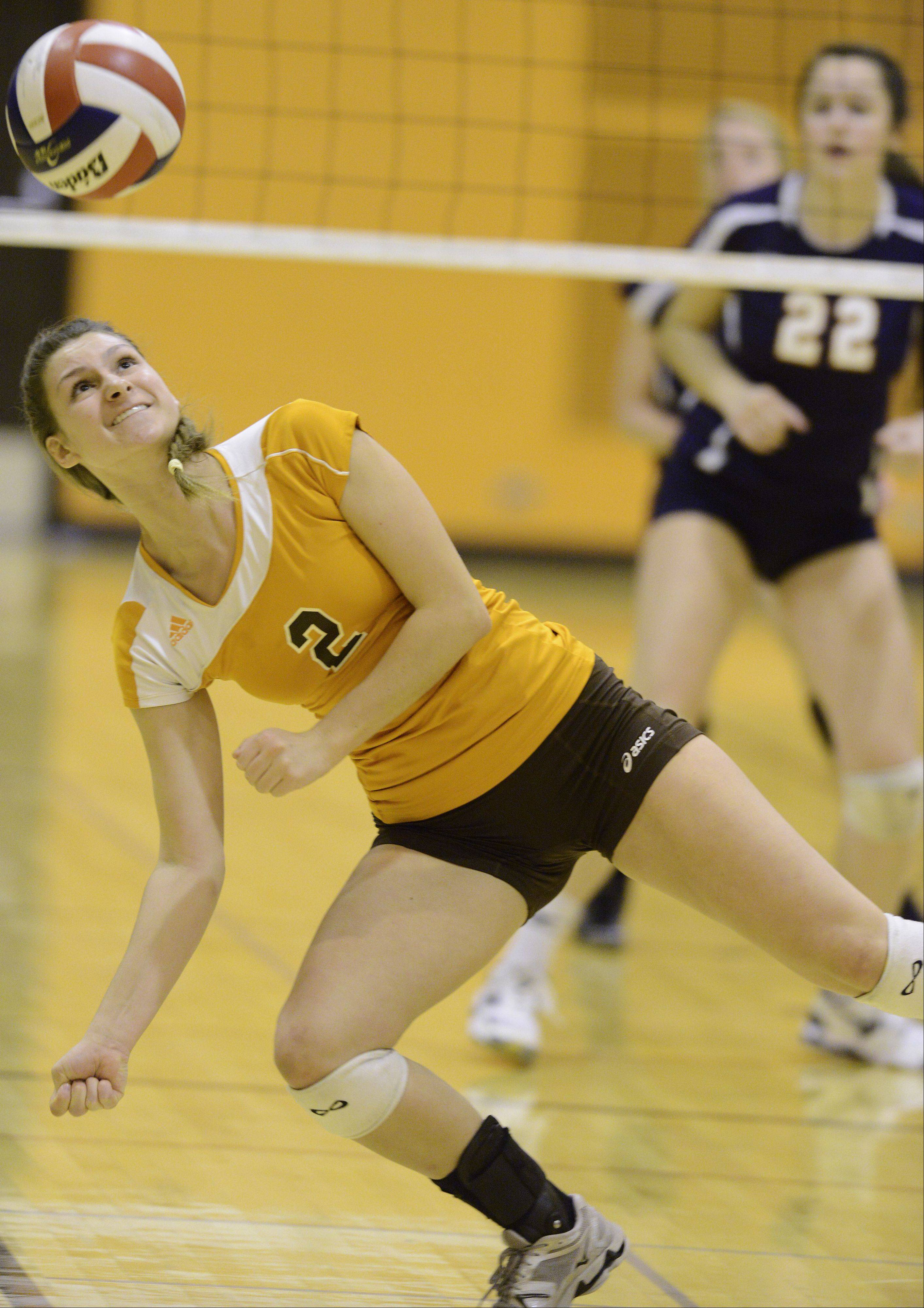 Hersey�s Megan Solans makes an off-balance effort to keep the ball in play against Buffalo Grove on Tuesday.