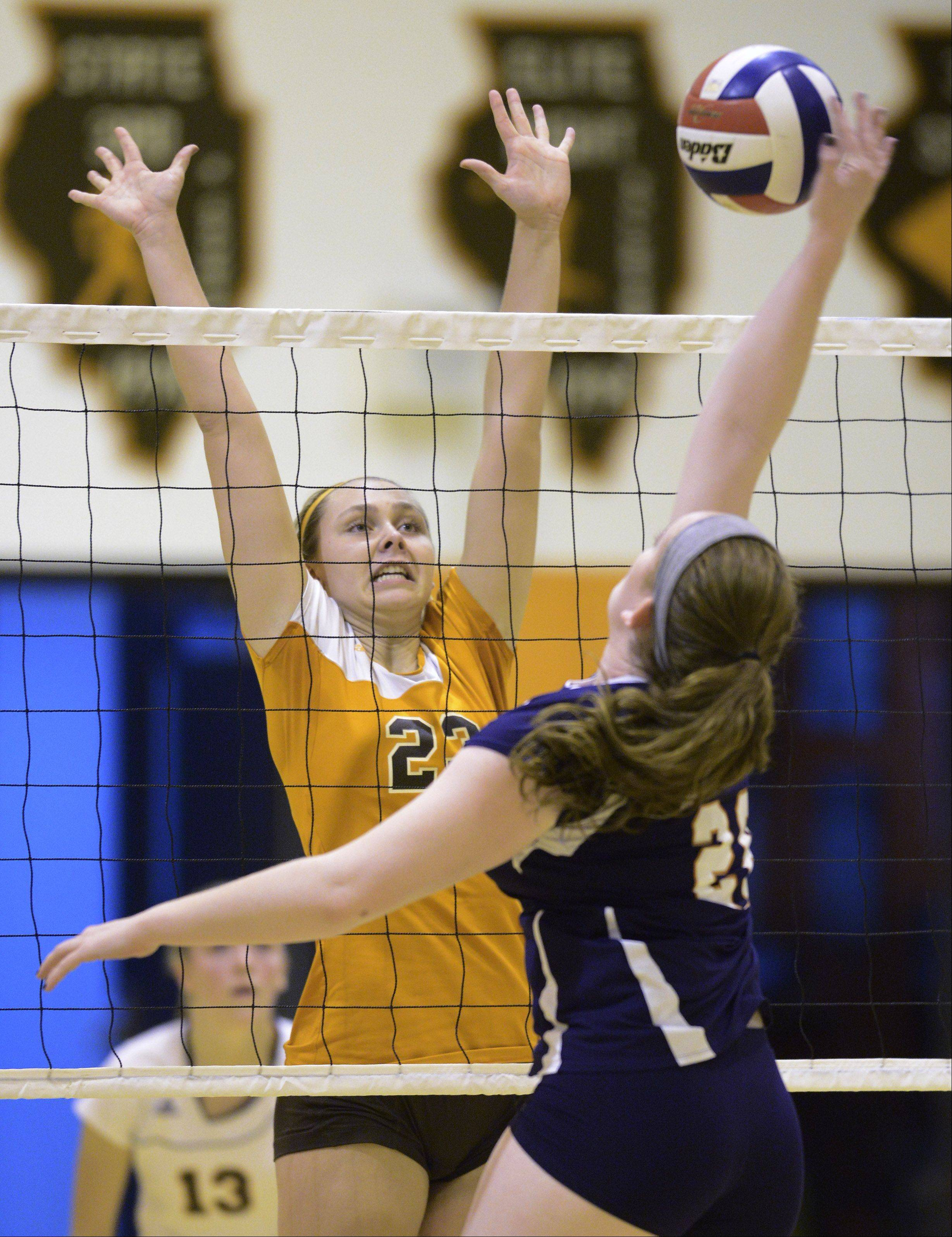 Hersey�s Liz Fuerst leaps for a block on a kill attempt by Buffalo Grove�s Colleen Nowlan on Tuesday.