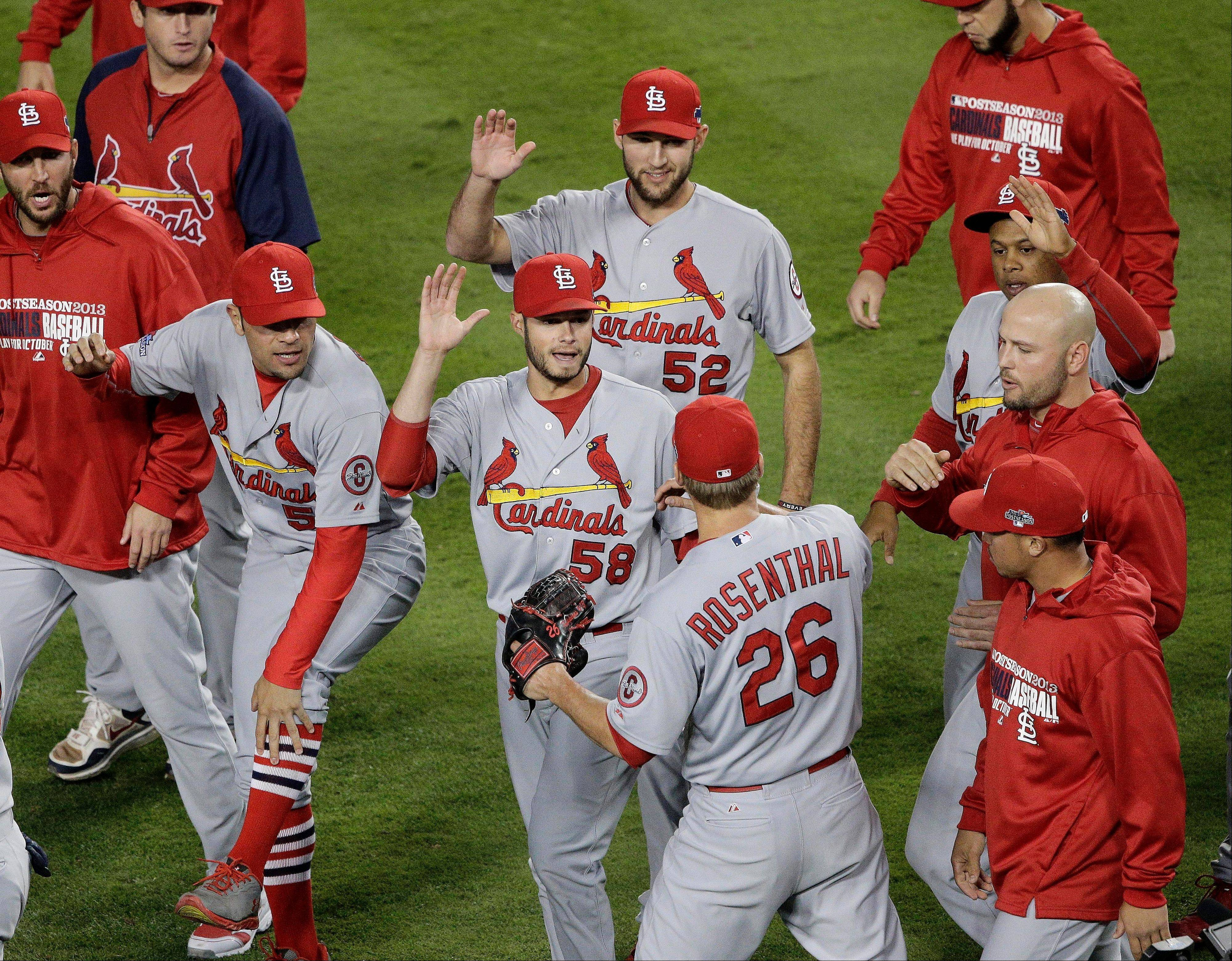 Cardinals relief pitcher Trevor Rosenthal (26) is congratulated by teammates after Game 4 of the National League Championship Series against the Los Angeles Dodgers on Tuesday in Los Angeles. The Cardinals won 4-2 to take a 3-1 lead in the series.