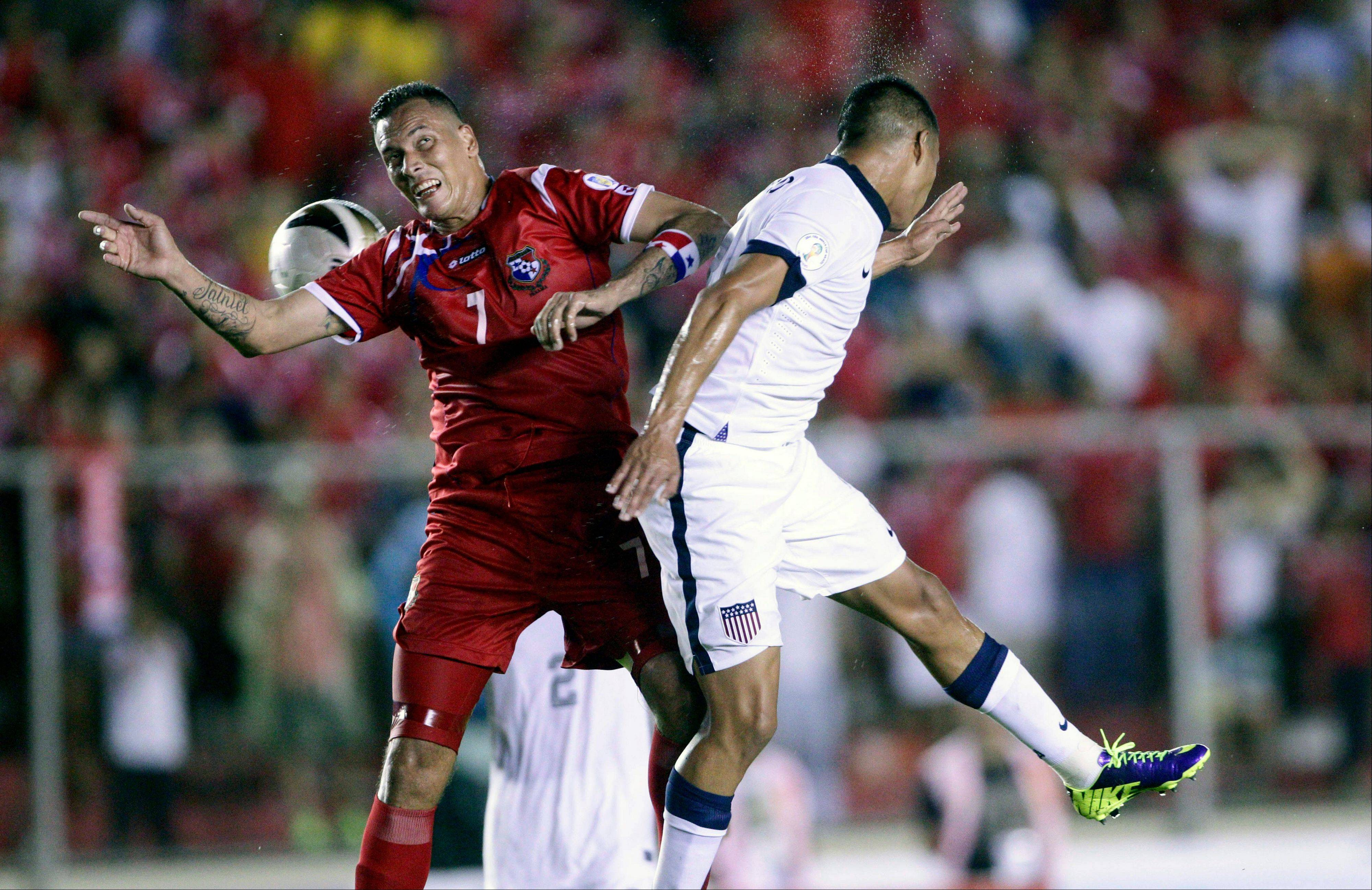 Team USA�s Edgar Castillo, right, and Panama�s Blas Perez go for a header Tuesday during a World Cup qualifying match in Panama City.