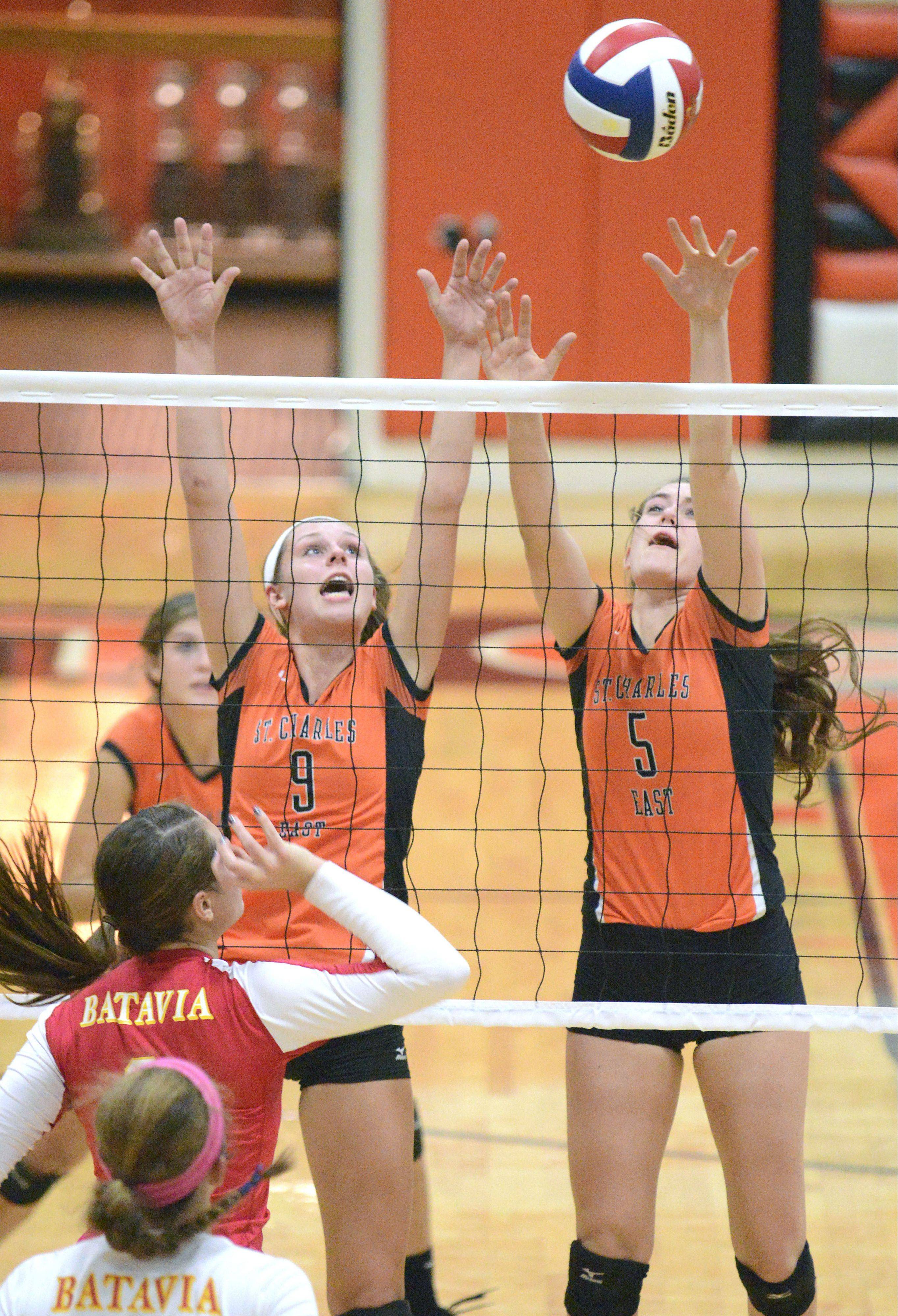 Above: St. Charles East�s Megan Schildmeyer and Alex Mazanke block a spike by Batavia�s Heather Meyer Tuesday in St. Charles. Right: Batavia�s Jancy Lundbergtries to hit past St. Charles East�s Dana Voltolina and Mazanke.