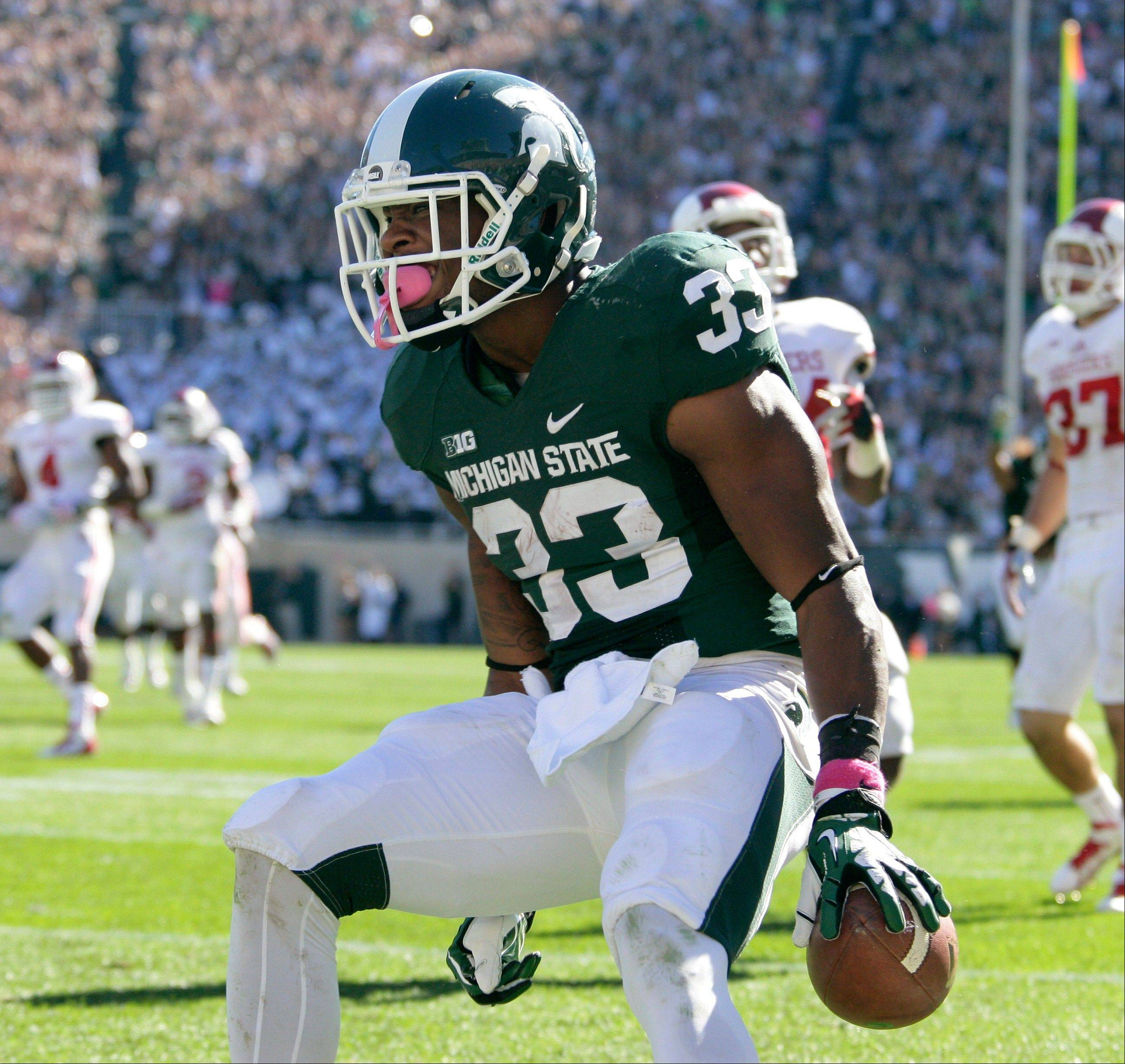 Michigan State�s Jeremy Langford celebrates his 32-yard touchdown during the third quarter of Saturday�s game against Indiana.