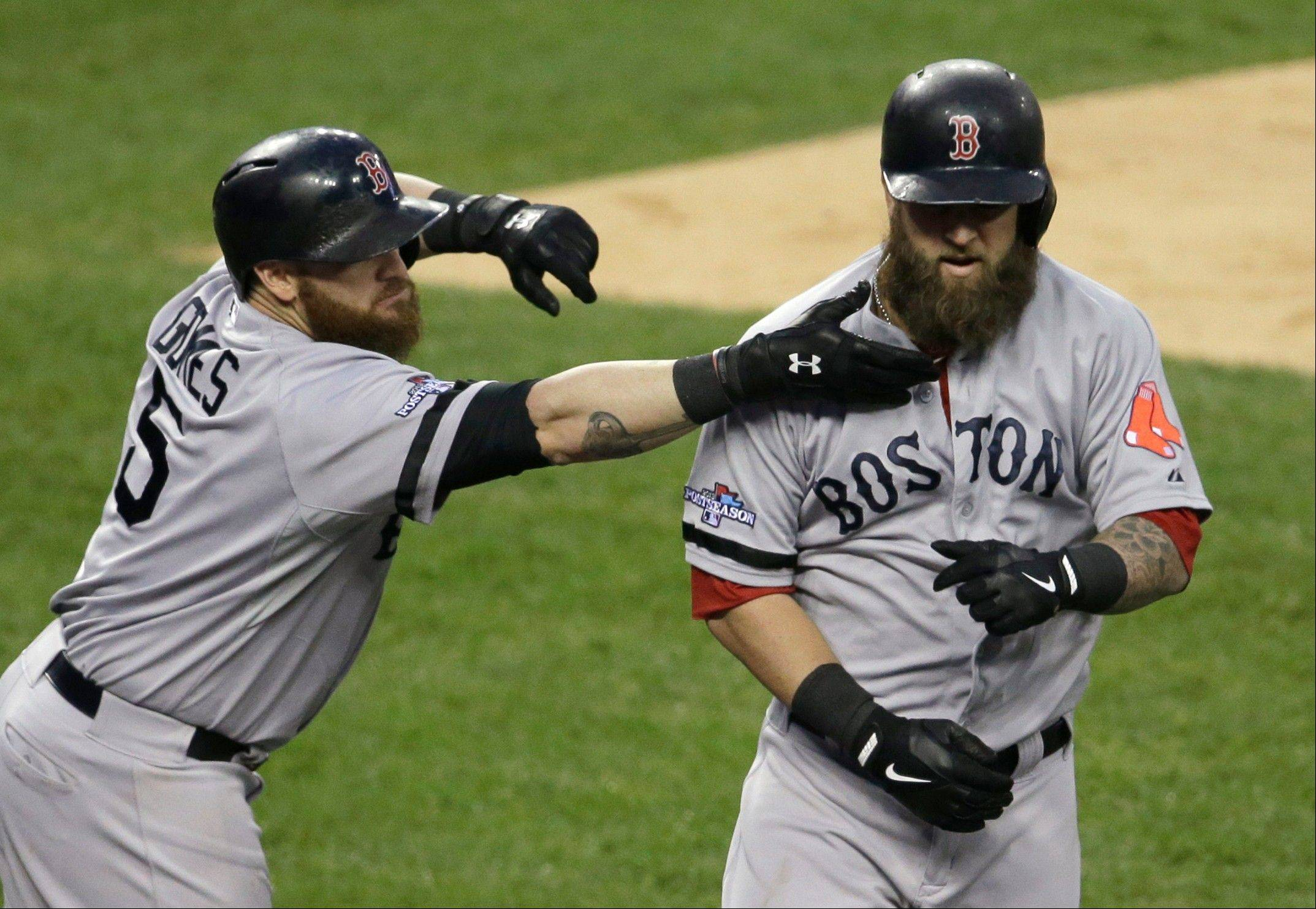 Boston�s Jonny Gomes reaches to pull the beard of Mike Napoli after Napoli hits a home run in the seventh inning during Game 3 of the American League Championship Series Tuesday in Detroit.