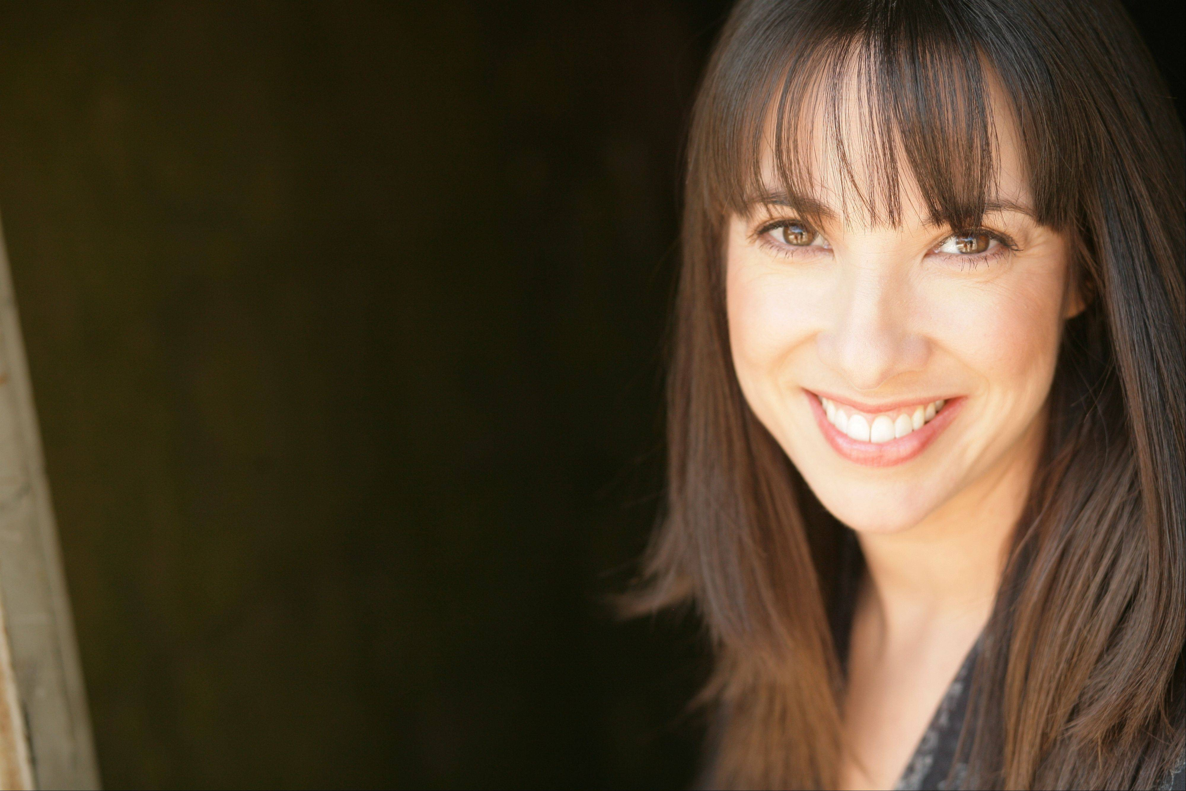 Patti Vasquez hits the stage at the Raue Center for the Arts in Crystal Lake on Friday, Oct. 18.