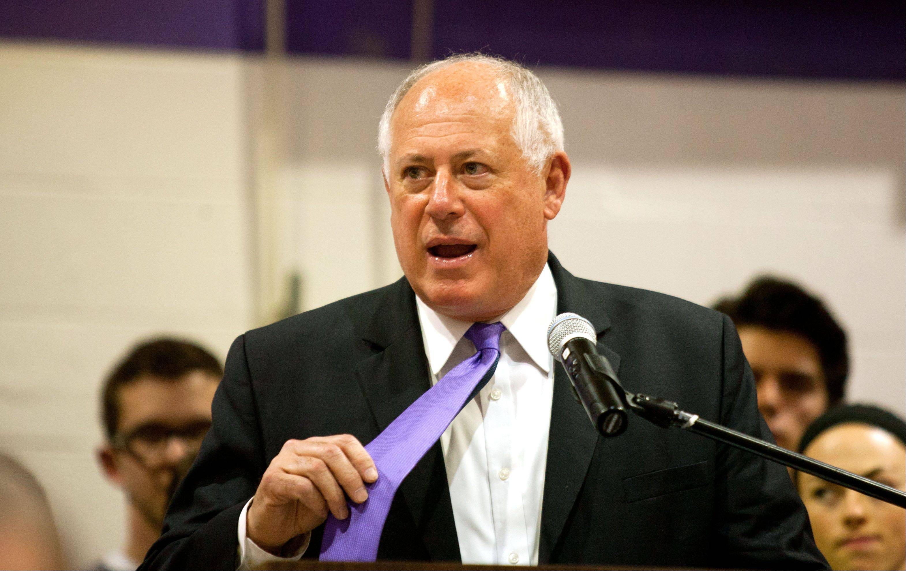 Gov. Pat Quinn, holding his lucky purple tie, said everyone should wear purple in support of Downers Grove North High School.