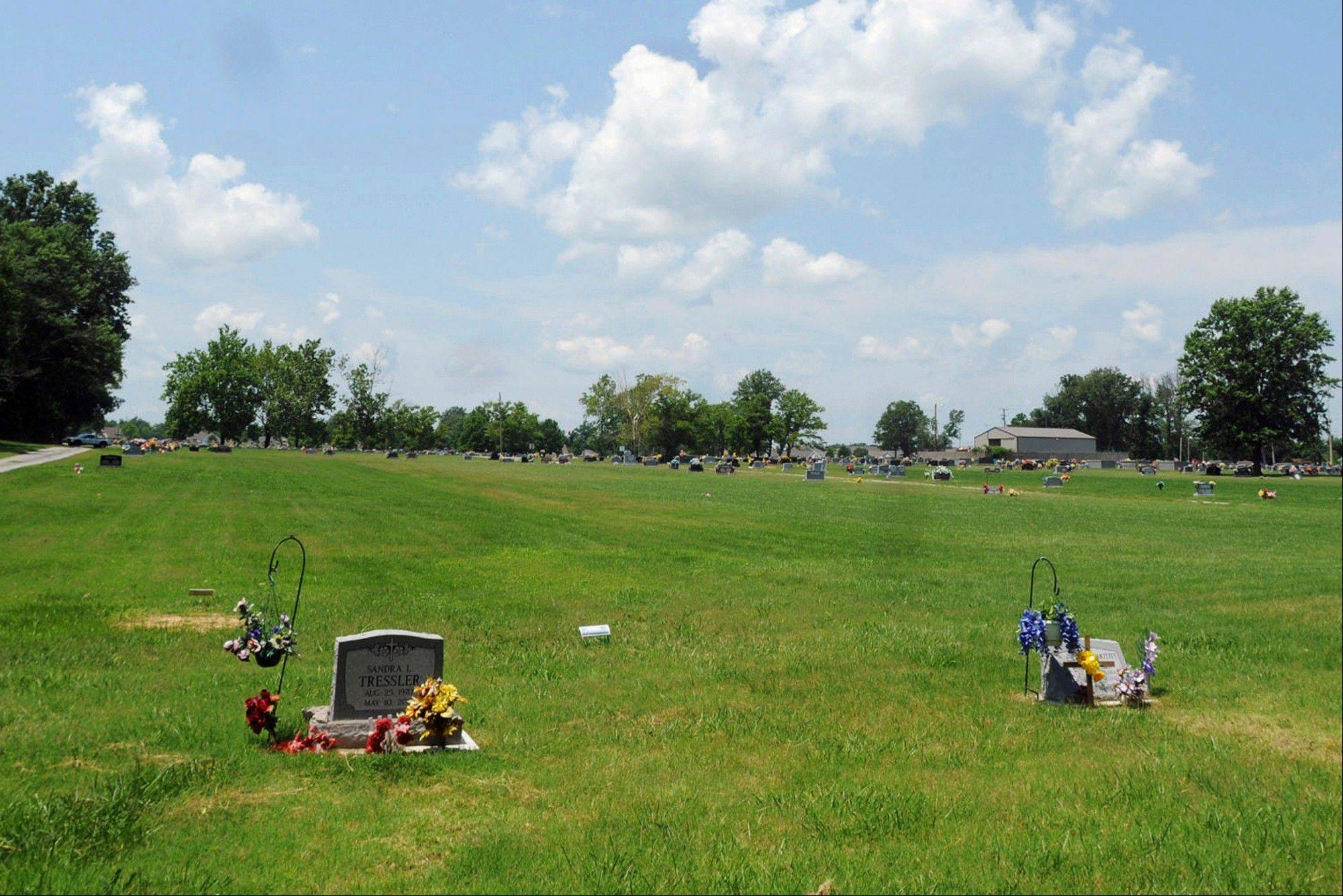 A portion of the Herrin Cemetery in Herrin, City leaders in the southern Illinois city agreed Monday, to give the go-ahead for more cemetery excavation work intended to find the remains of victims of a violent 1922 labor strike that killed dozens of replacement workers.