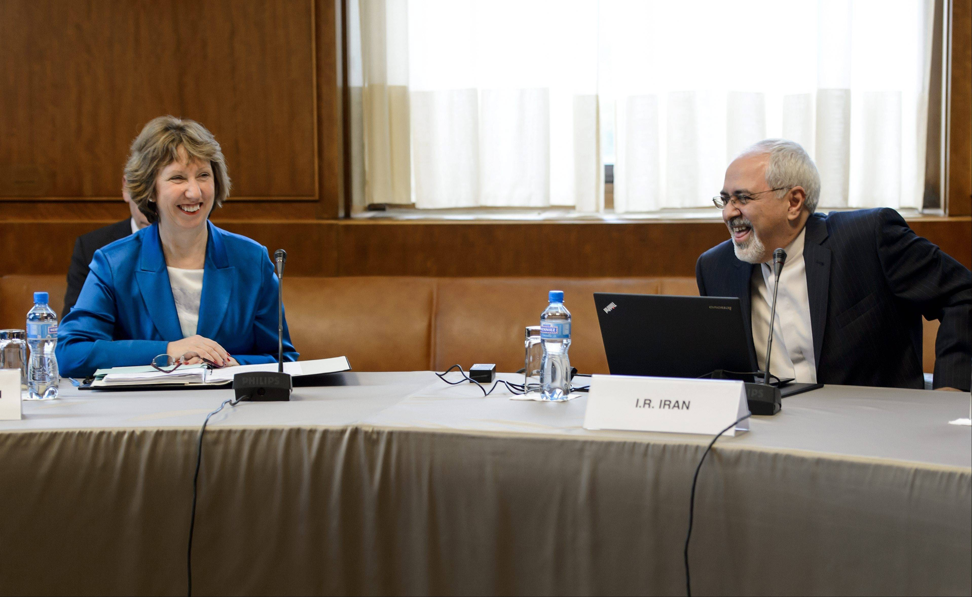 EU High Representative for Foreign Affairs Catherine Ashton, left, and Iranian Foreign Minister Mohammad Javad Zarif share a light moment at the start of the two days of closed-door nuclear talks Tuesday at the United Nations offices in Geneva, Switzerland.