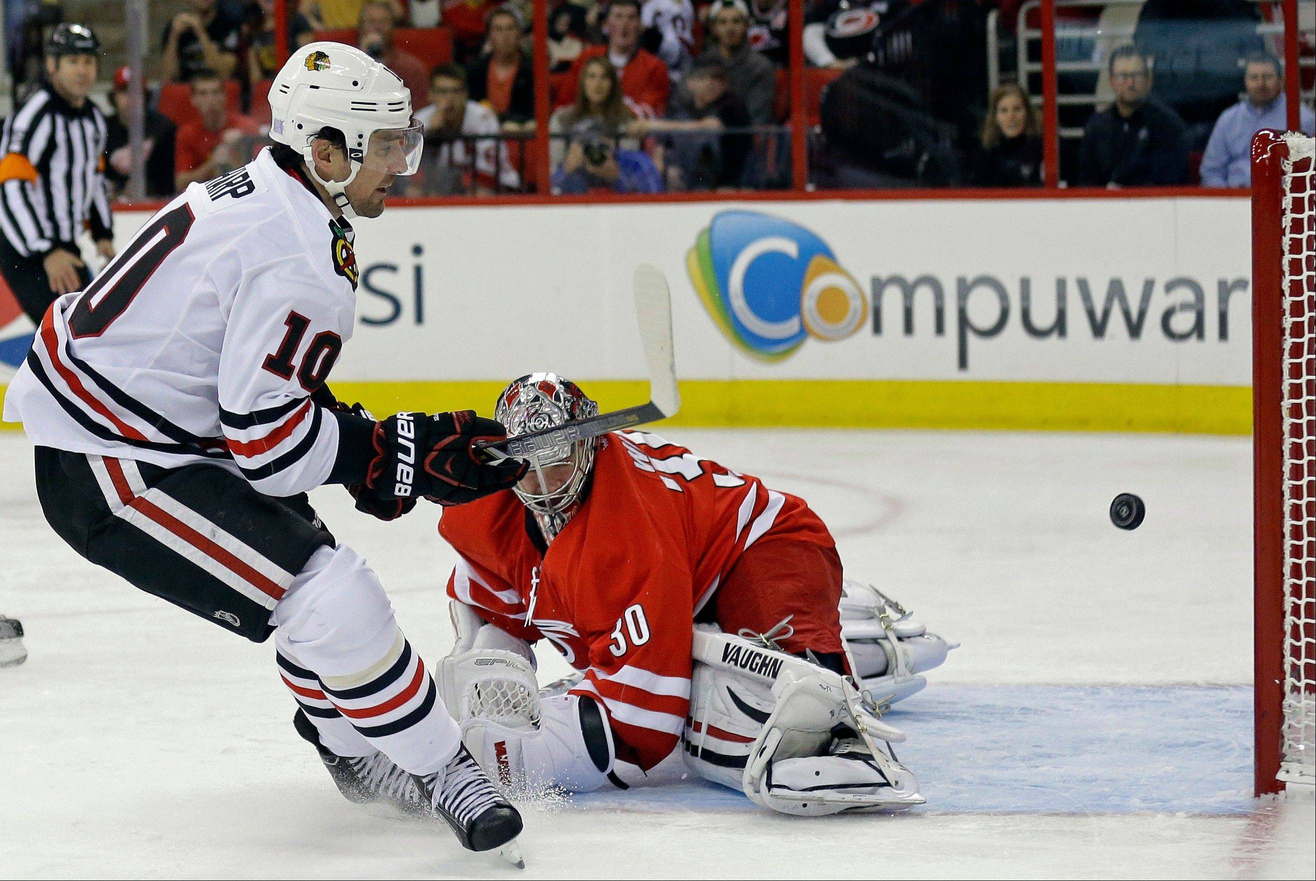 Patrick Sharp scores on Hurricanes goalie Cam Ward during the first period Tuesday night for his first goal of the season. Sharp also scored the only goal in the shootout.
