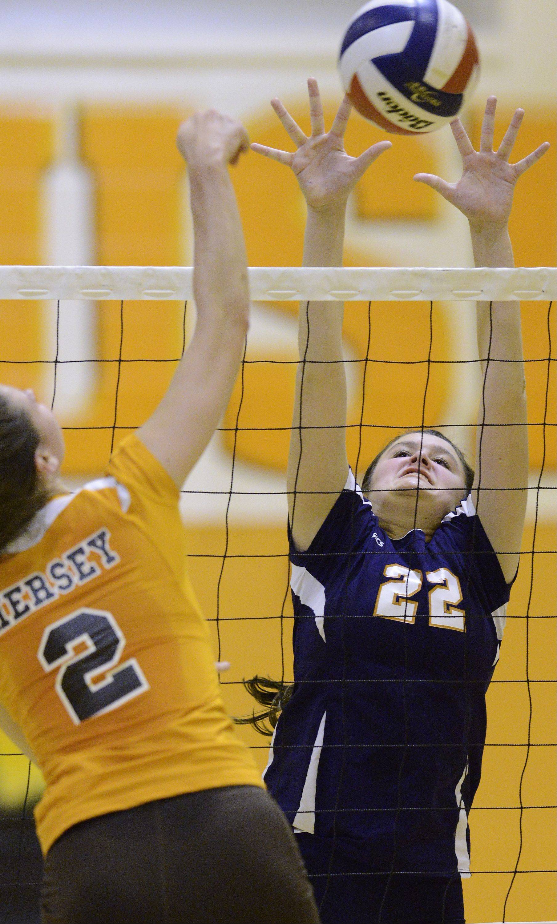 Buffalo Grove's Marie Georgoulis, right, leaps for a block on a ball hit by Hersey's Megan Solans.