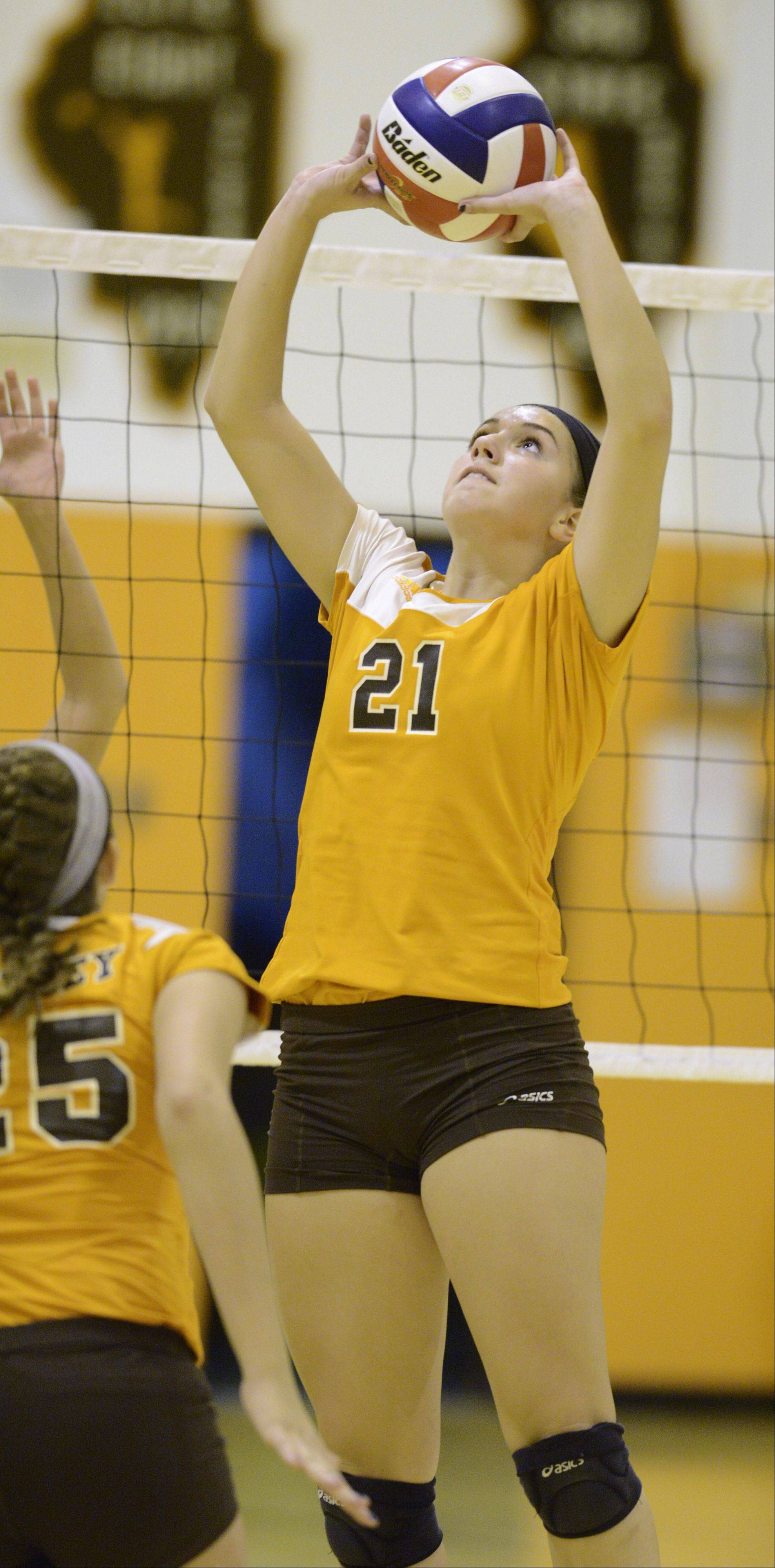 Hersey's Courtney Stedman sets the ball during Tuesday's match against Buffalo Grove.
