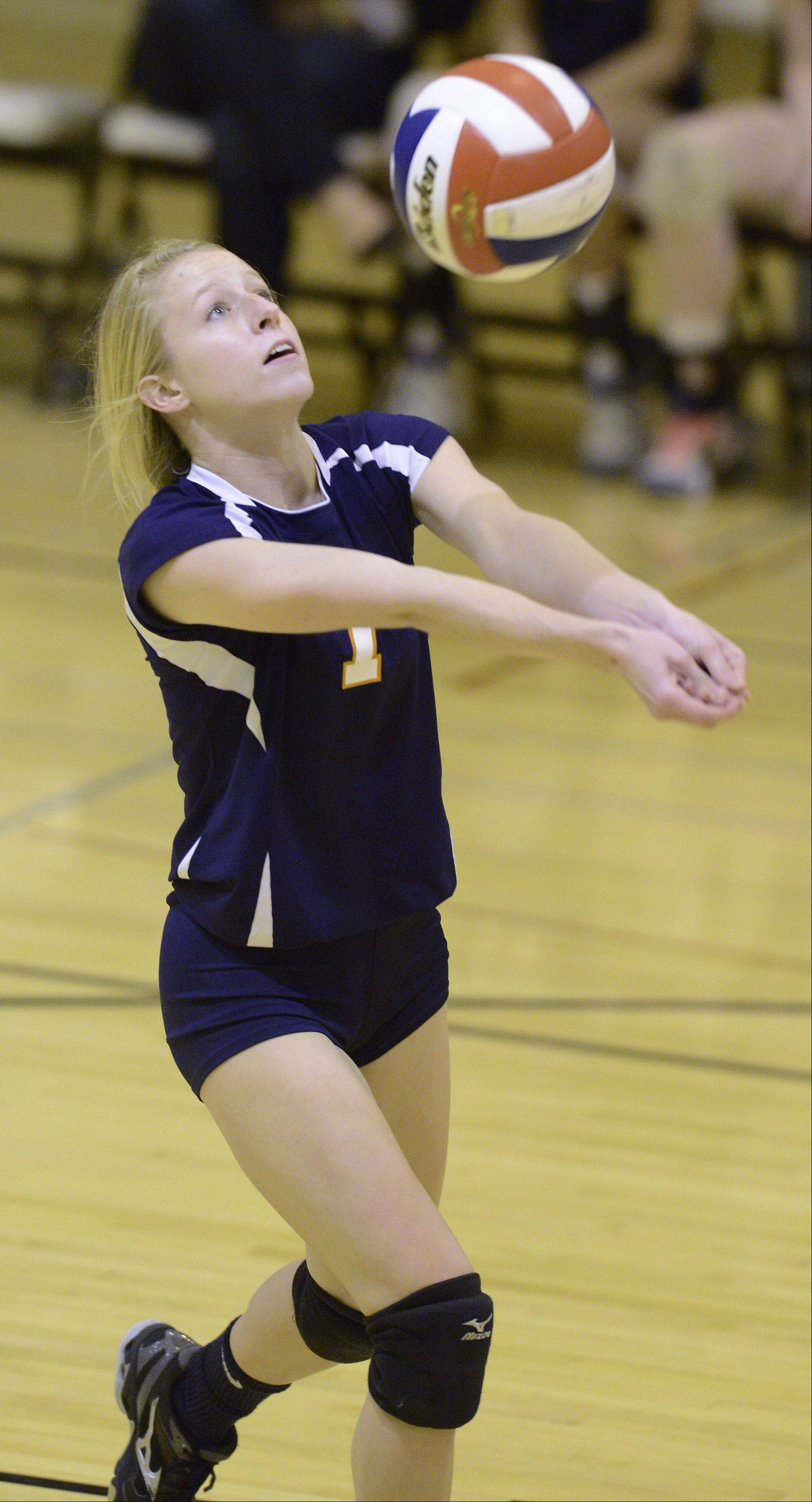 Buffalo Grove's Meghan Chartier hustles for a dig against Hersey on Tuesday.