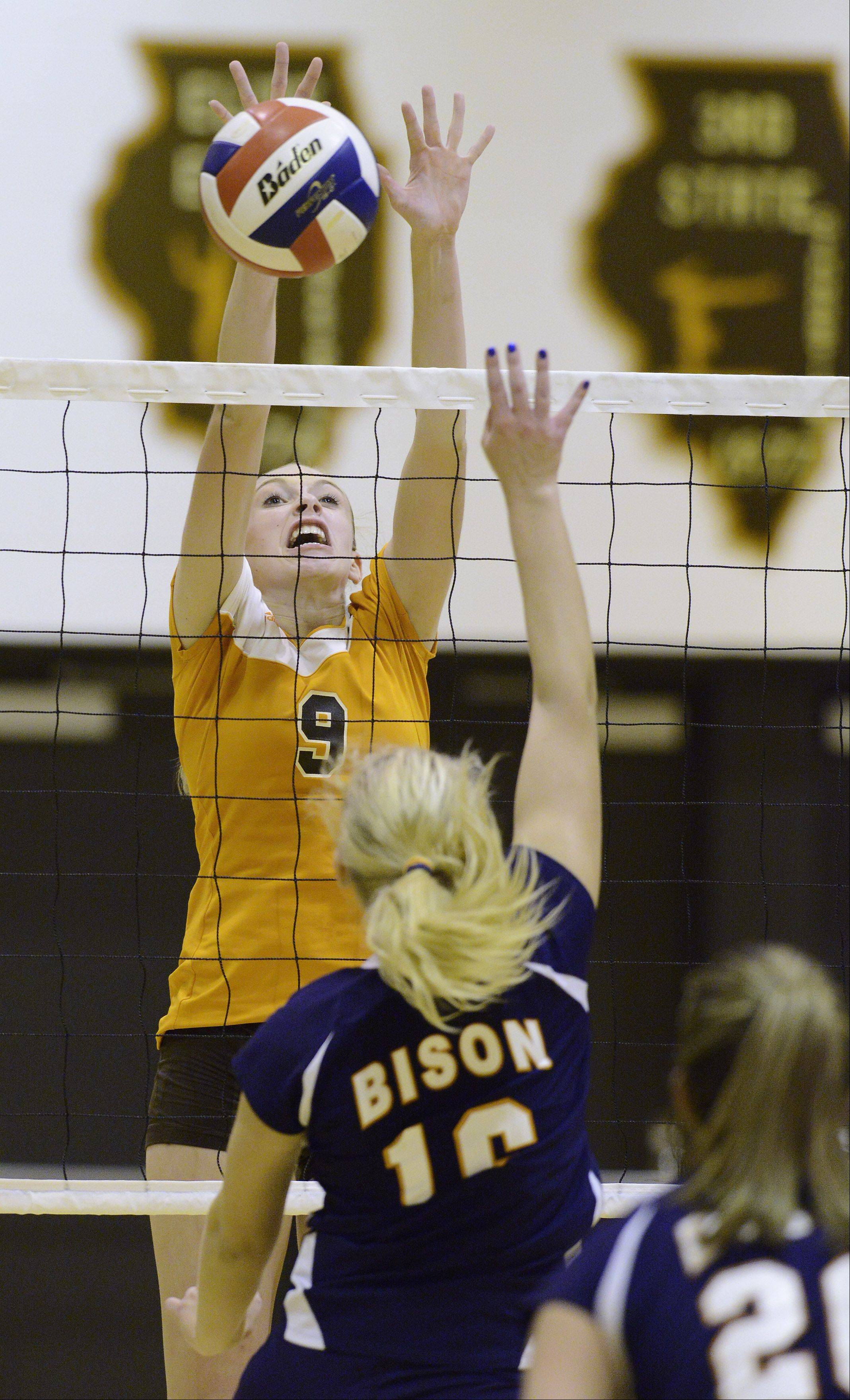 Hersey's Katie Rozanski blocks a ball hit by Buffalo Grove's Alicia Kantor on Tuesday.