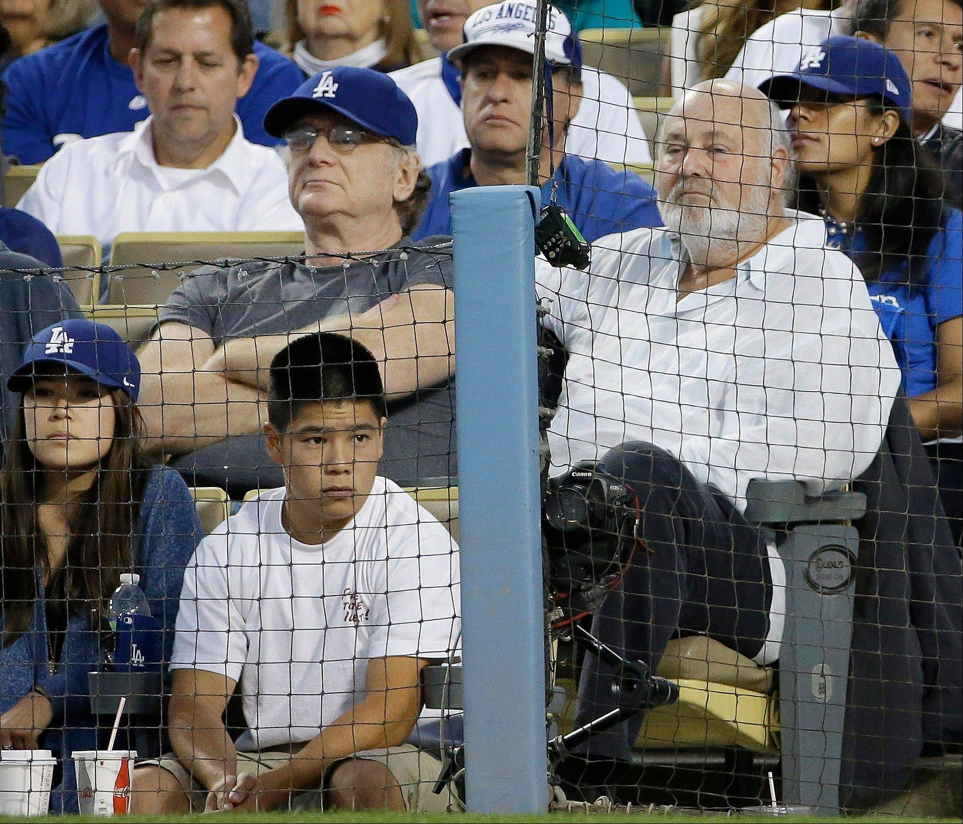 Actor Rob Reiner, right, watches play during the fourth inning of Game 4.