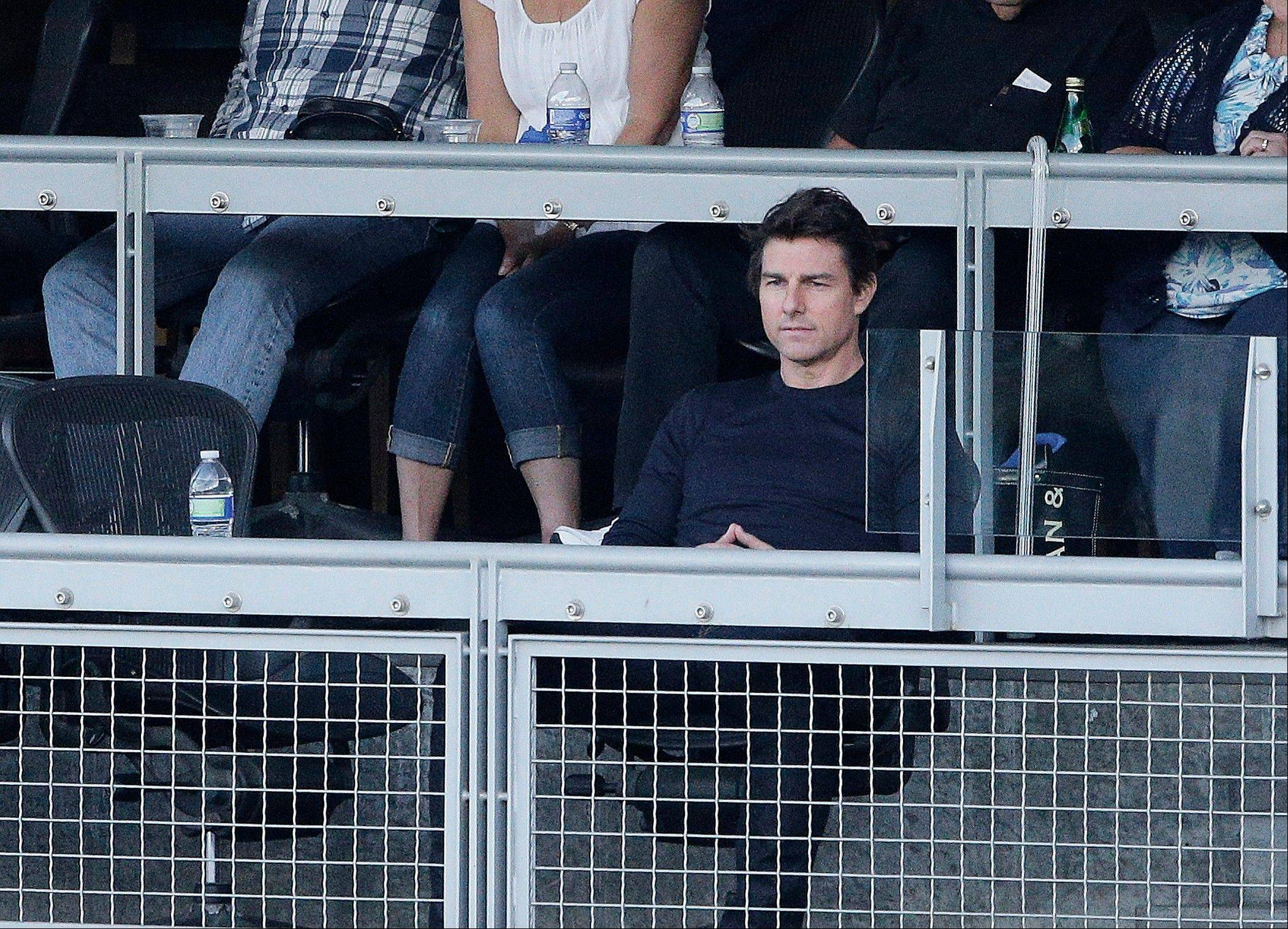 Actor Tom Cruise watches the game Tuesday in Los Angeles.