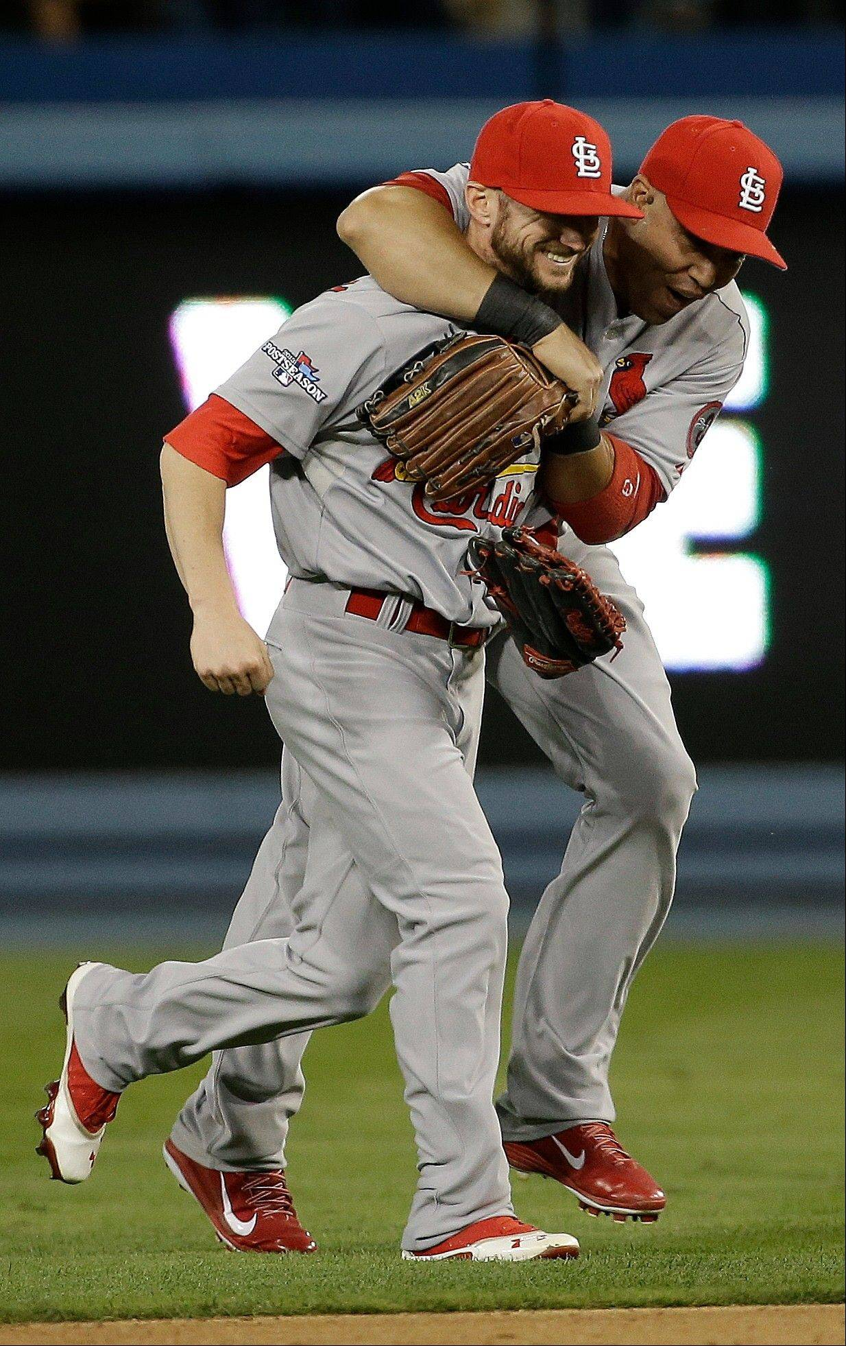 The Cardinals' Shane Robinson and Carlos Beltran, right, celebrate after Game 4.