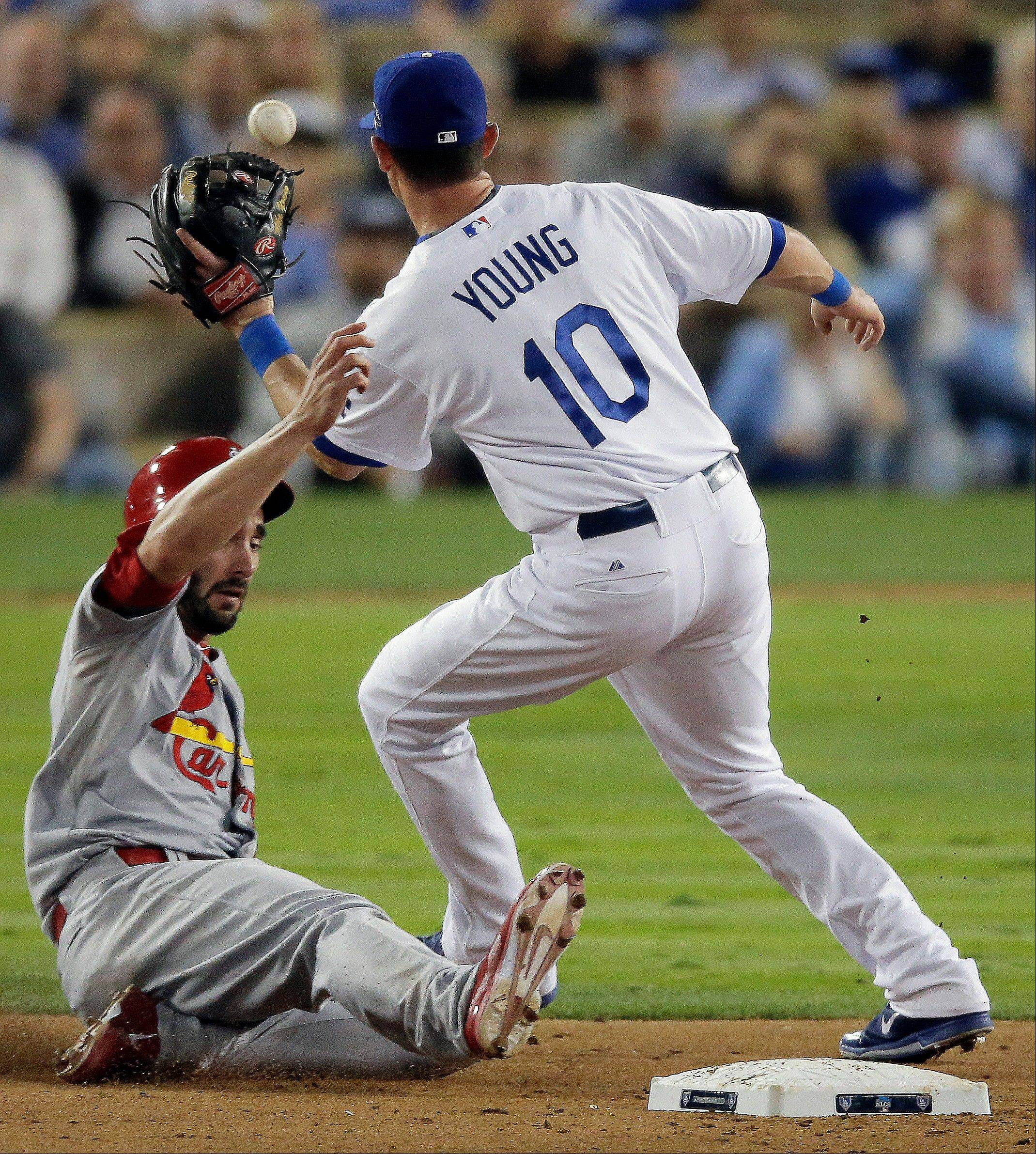 The Cardinals' Matt Carpenter steals second with the Dodgers' Michael Young covering during the ninth inning of Game 4.