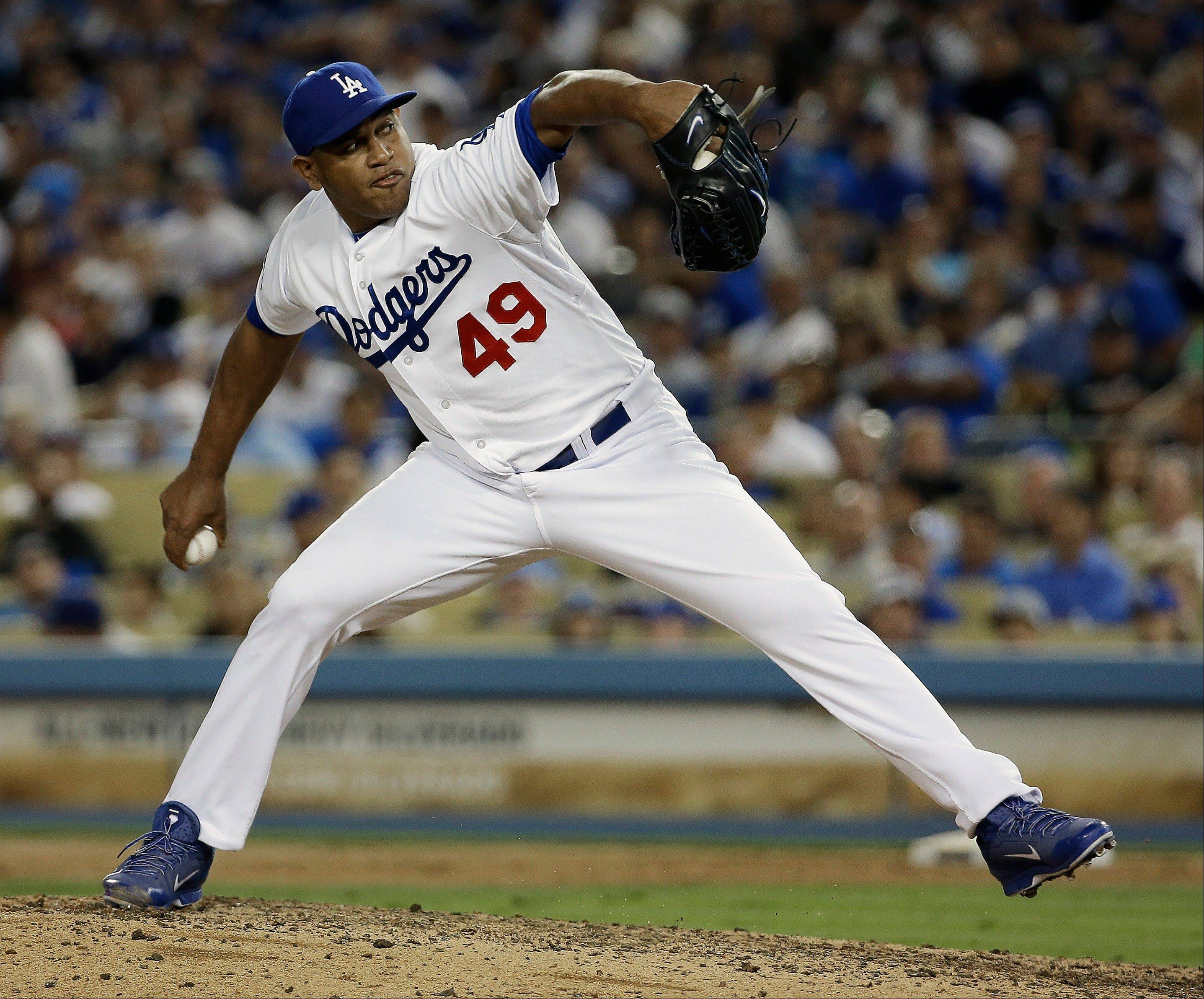 Dodgers reliever Carlos Marmol throws during the eighth inning of Game 4.