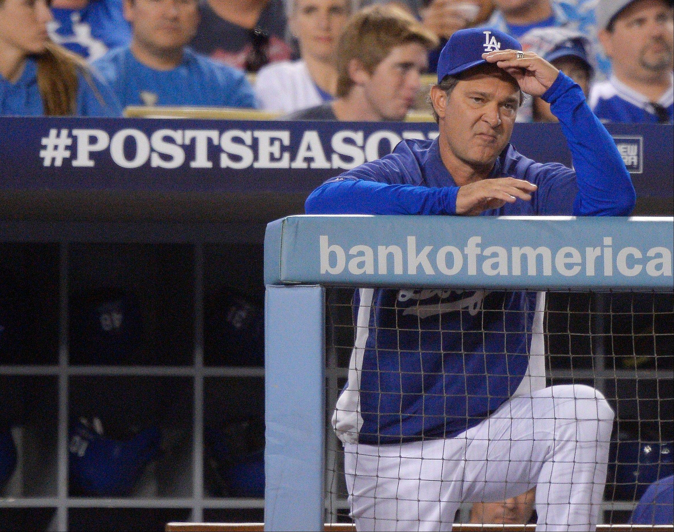 Dodgers manager Don Mattingly watches during the sixth inning.