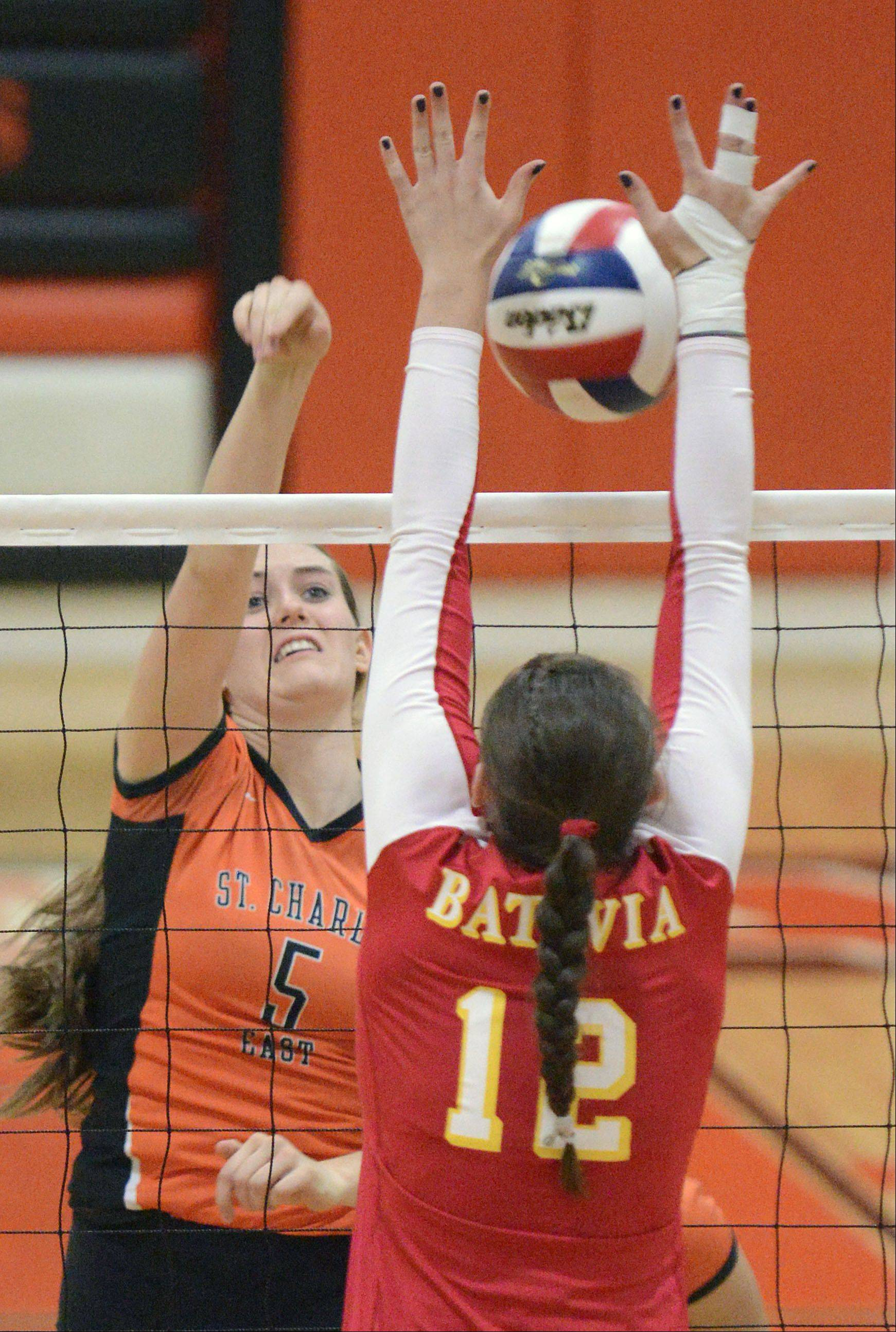 St. Charles East's Alex Mazanke attempts to spike past Batavia's Shea Thayer in the second match on Tuesday, October 14.