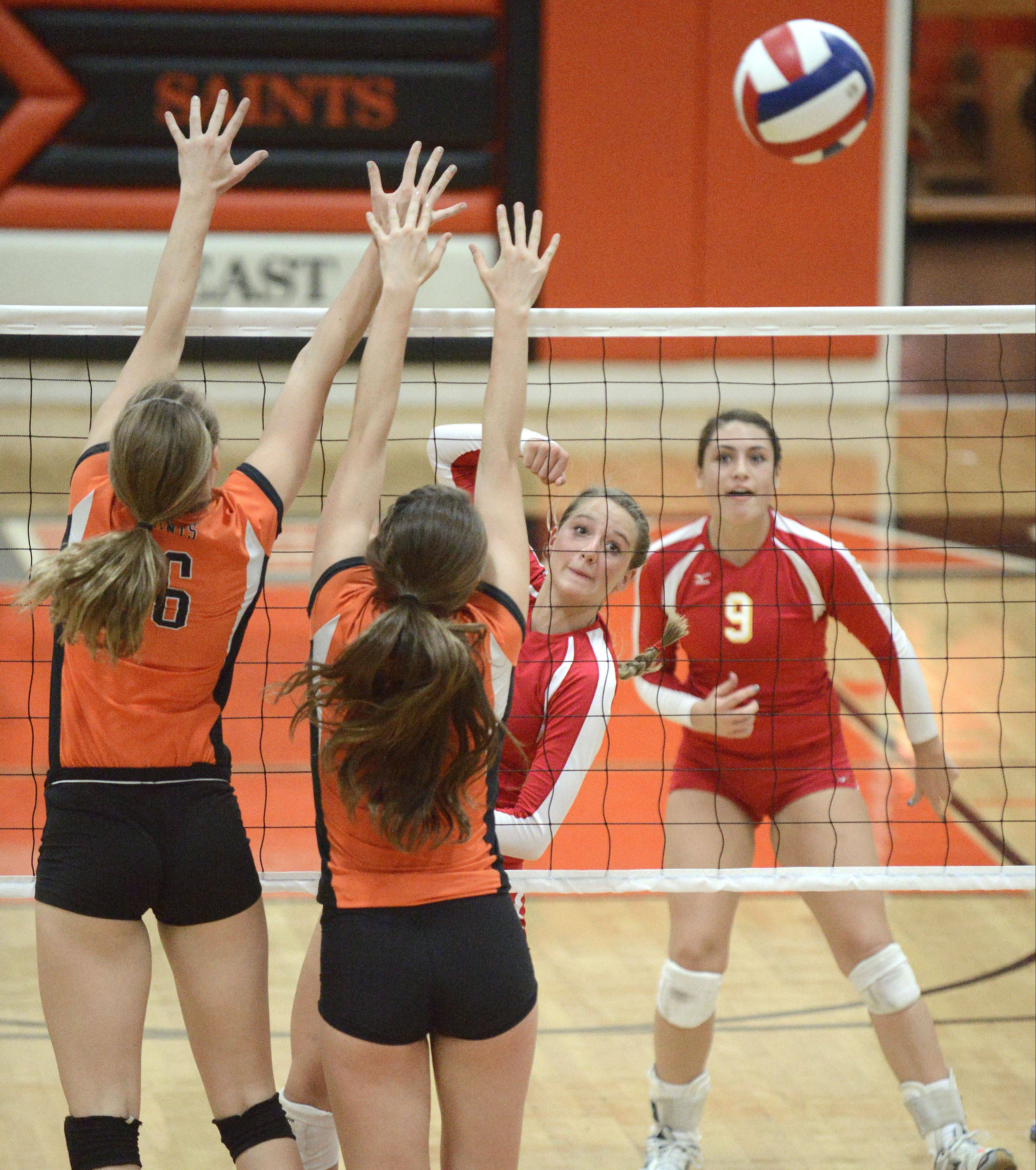 St. Charles East's Dana Voltolina and Alex Mazanke attempt to block a spike by Batavia's Jancy Lundberg in the first match on Tuesday, October 14.