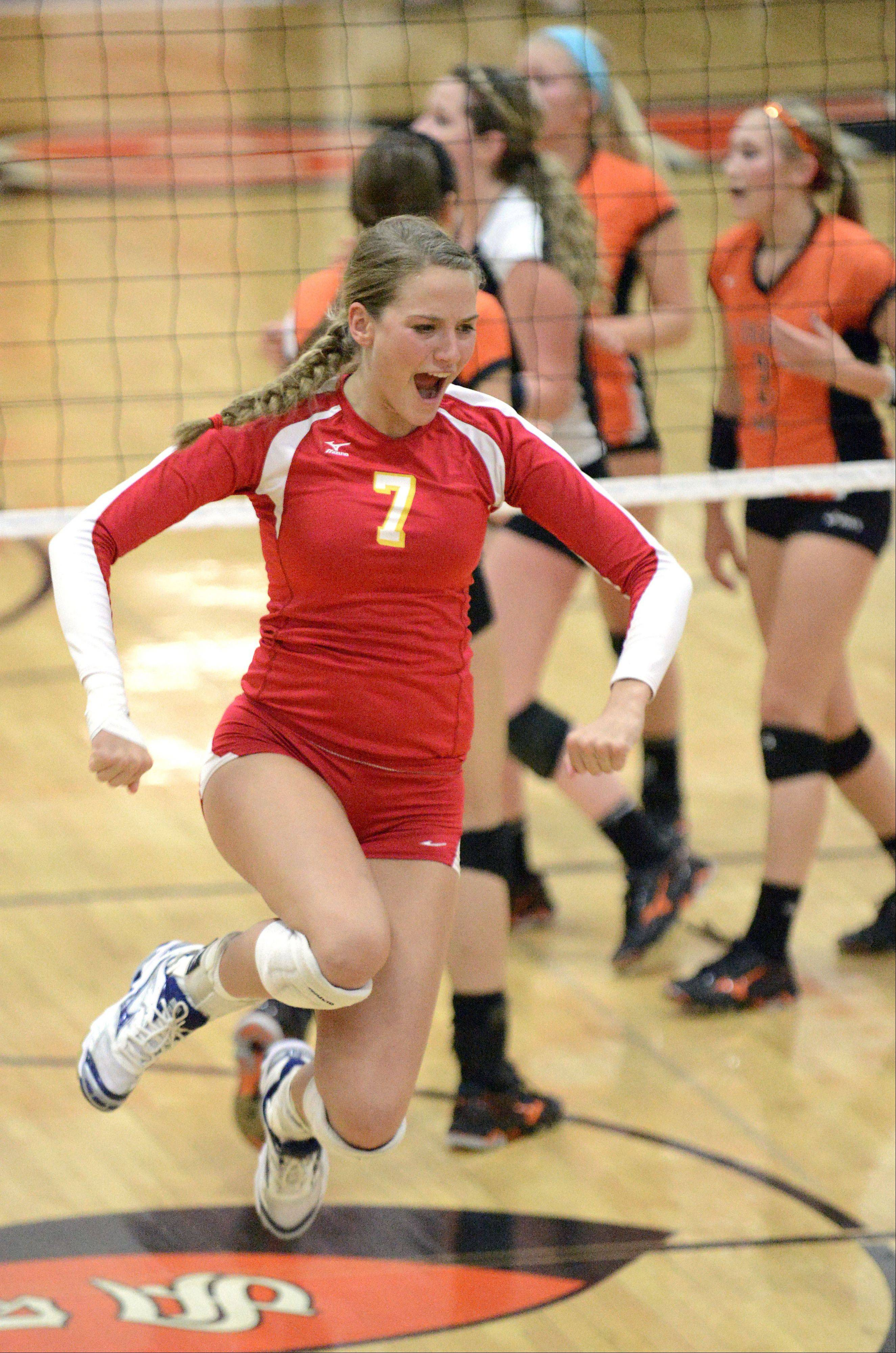 Batavia's Jancy Lundberg leaps for joy after the Bulldogs score a point over St. Charles East in the second match on Tuesday, October 14.