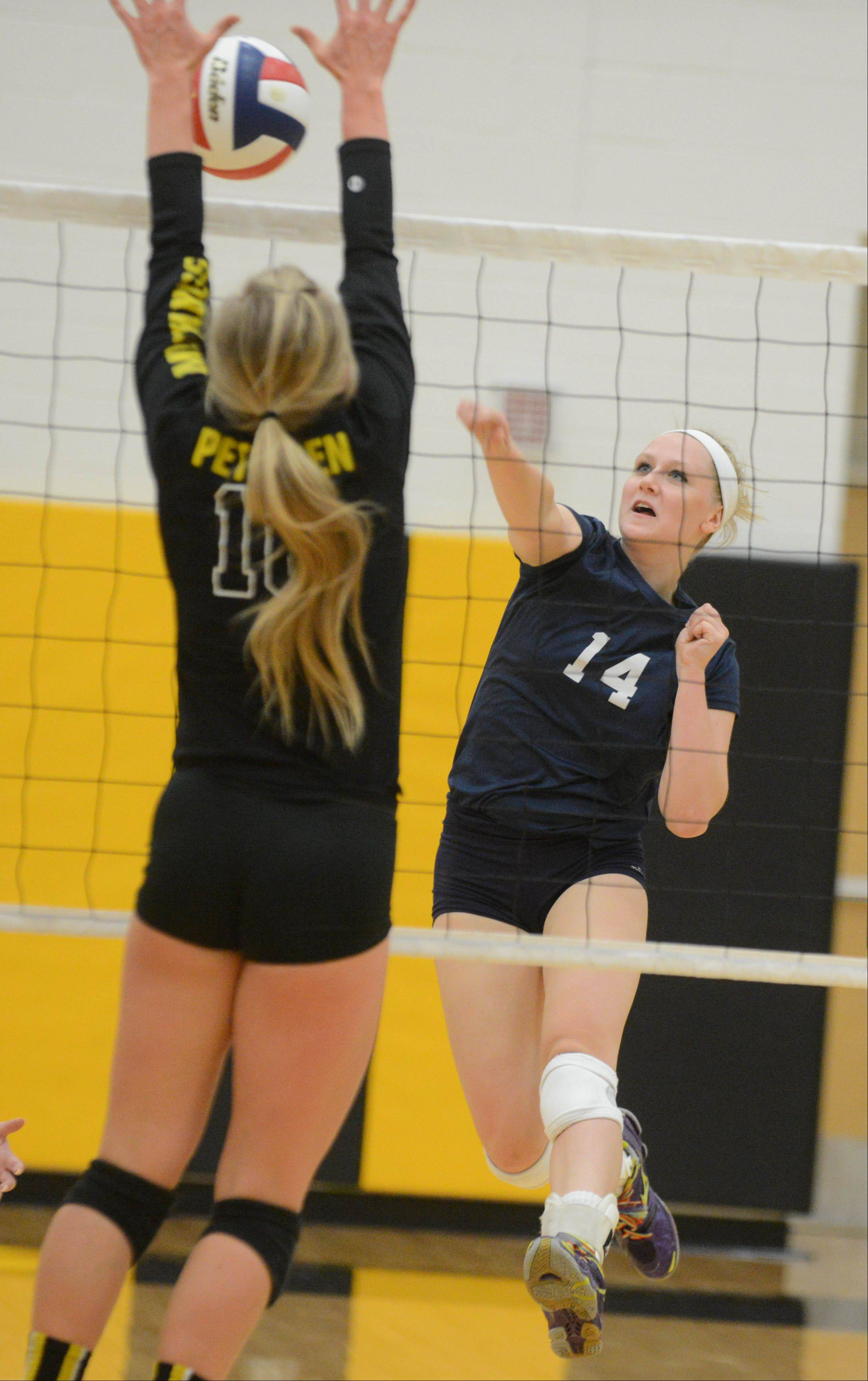 Paul Michna/pmichna@dailyherald.comRachel Hartford of Bartlett spikes the ball during the Bartlett at Metea Valley girls volleyball game Tuesday.