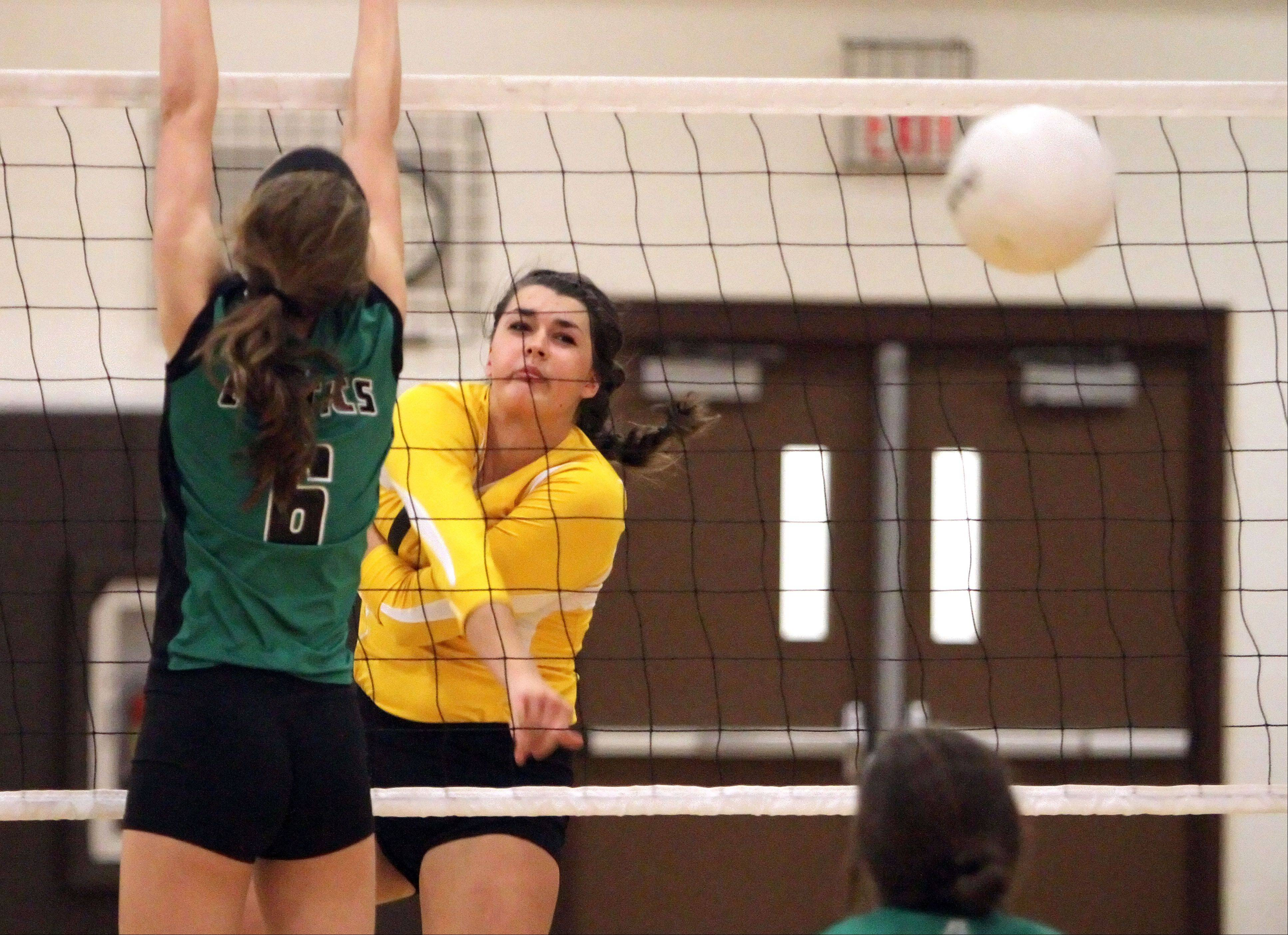 Carmel's Grace Schofield spikes one past Providence Catholic's Rachel Alles on Tuesday night in Mundelein.