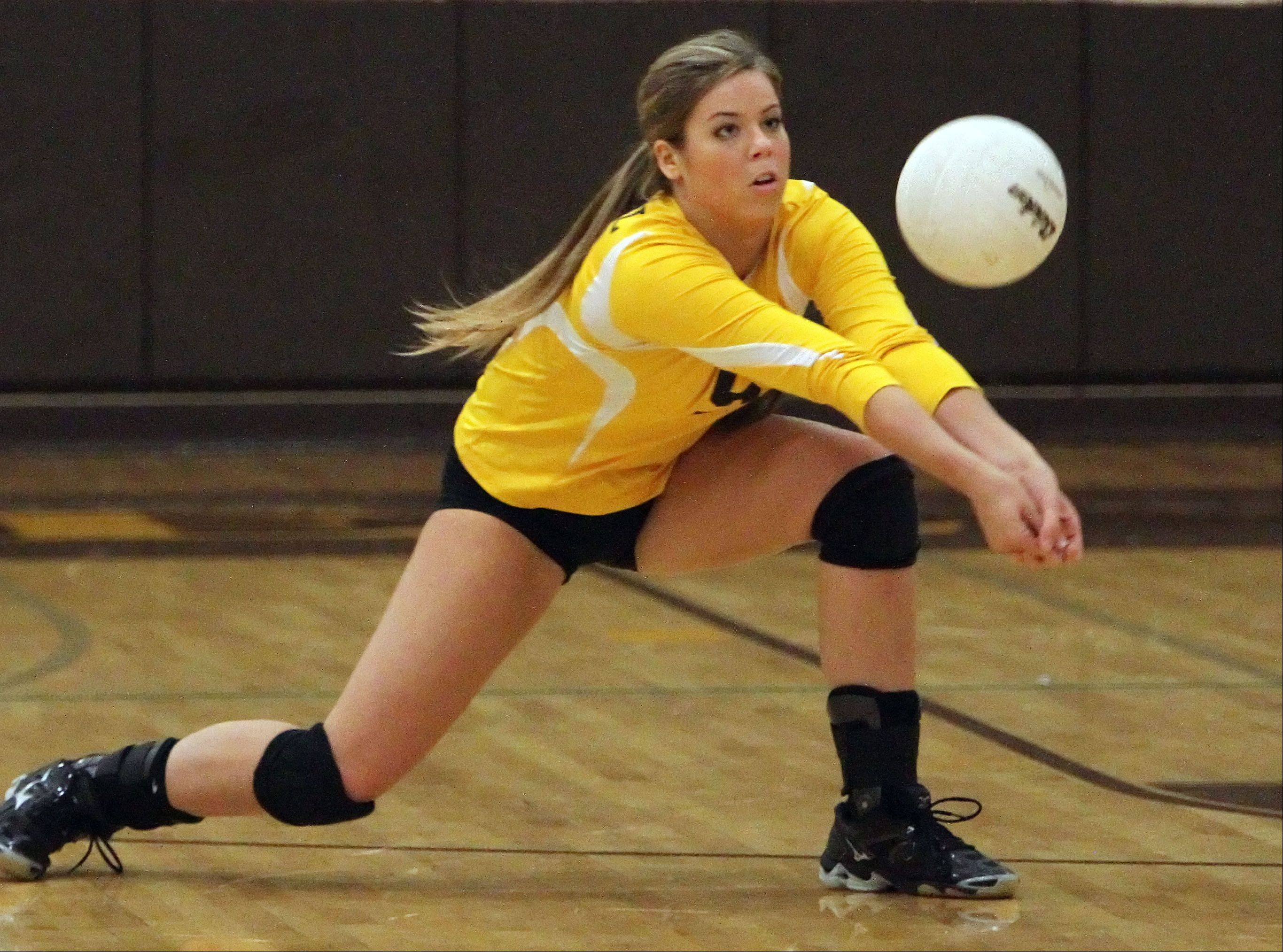 Carmel's Allie Wayland digs out a serve against Providence Catholic on Tuesday in Mundelein.