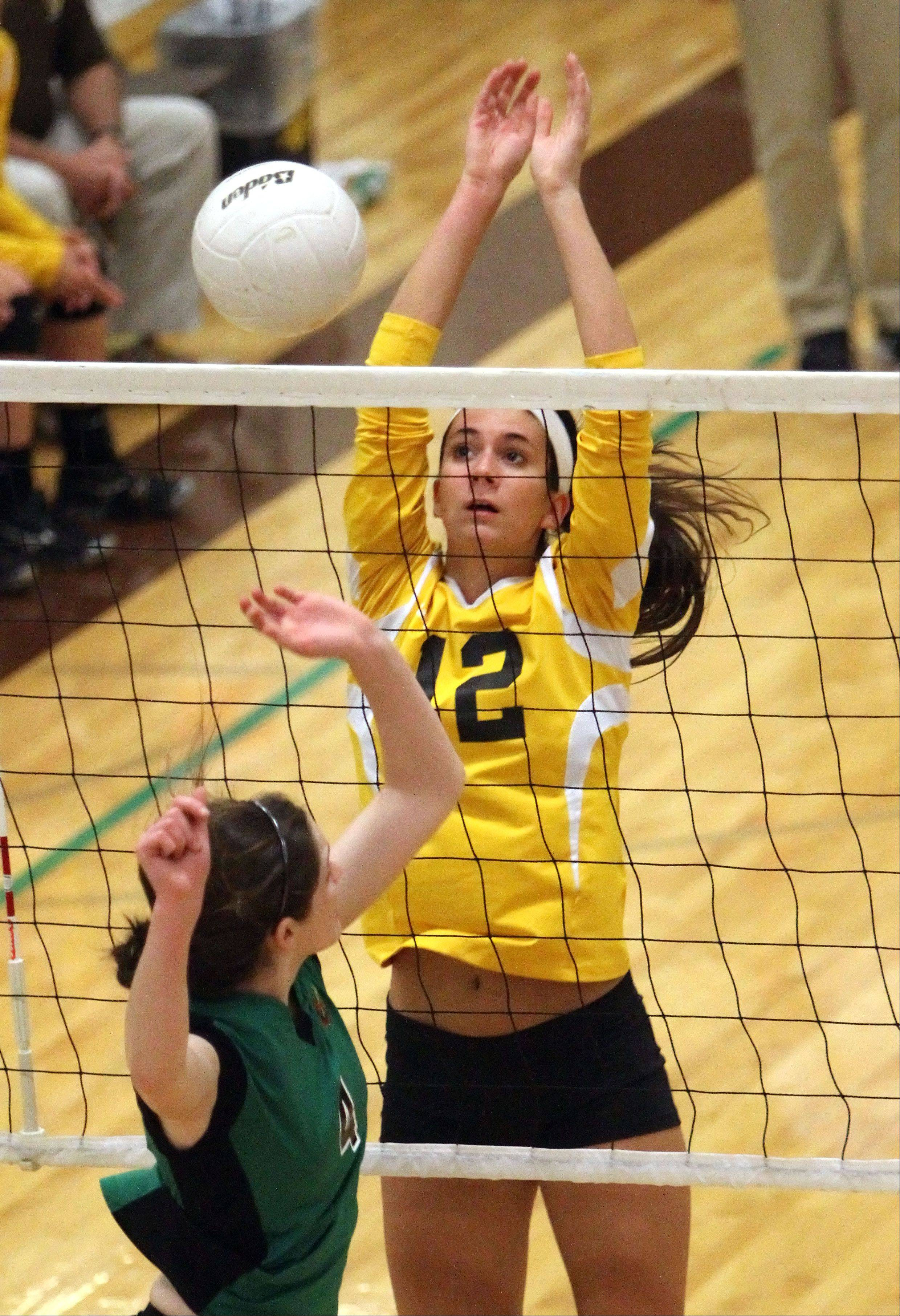 Carmel's Haley Nedelka goes up to block the shot of Providence Catholic's Annie Cummings on Tuesday night in Mundelein.