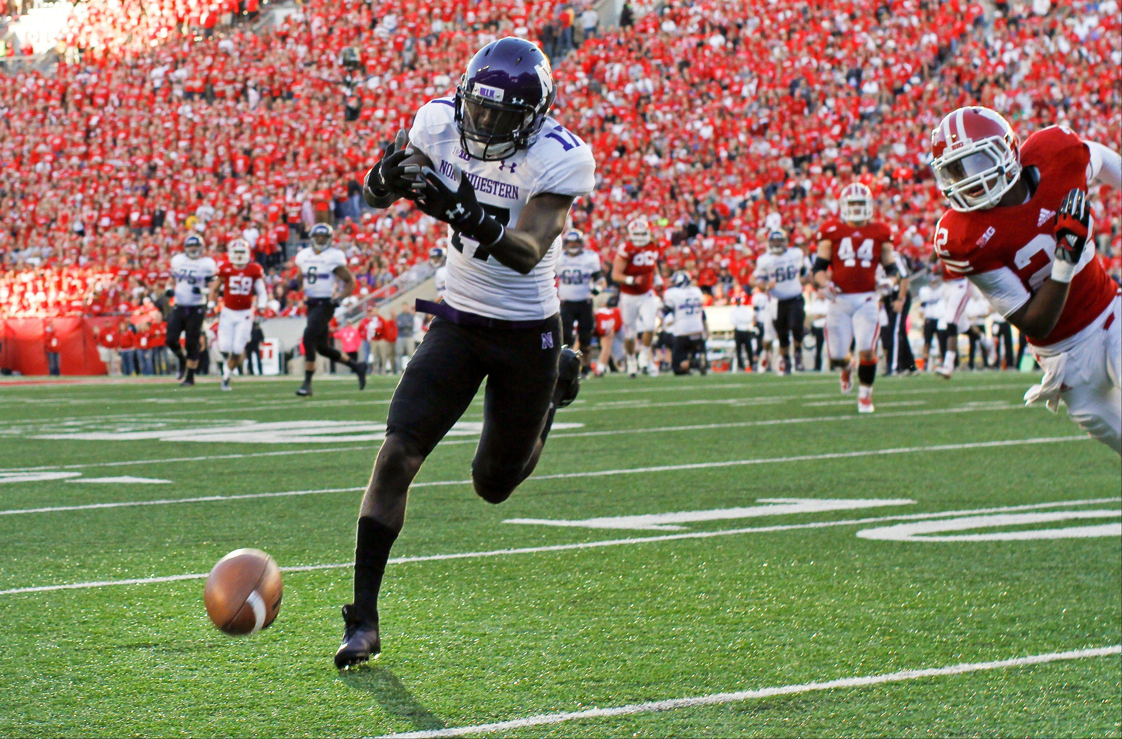 Northwestern wide receiver Rashad Lawrence misses a pass in last Saturday's loss to Wisconsin. The Wildcats will look to end a two-game slide when Minnesota comes to Evanston this weekend.