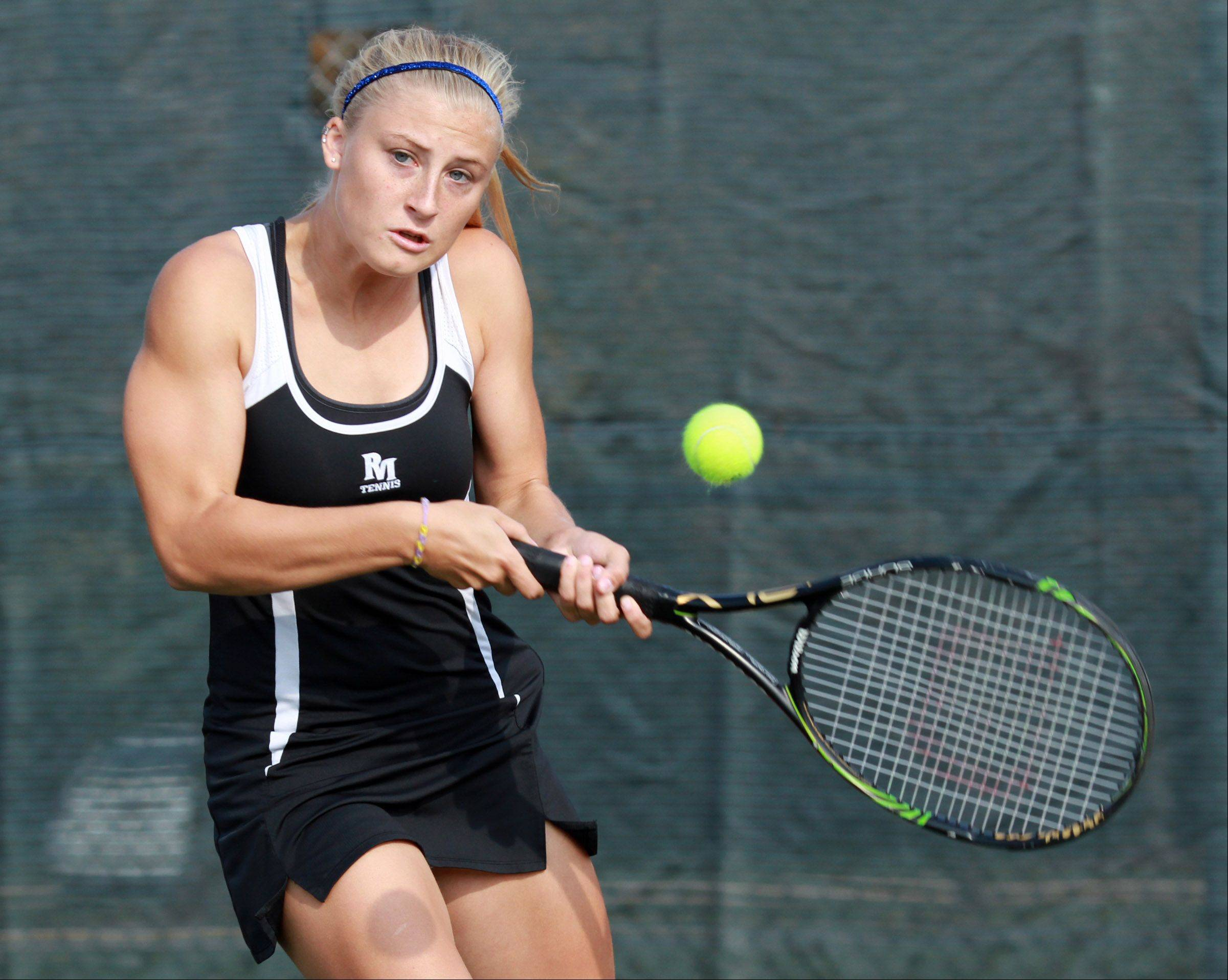 Rolling Meadow's Jackie Kemph eyes the ball during her doubles match against Barrington on Saturday.