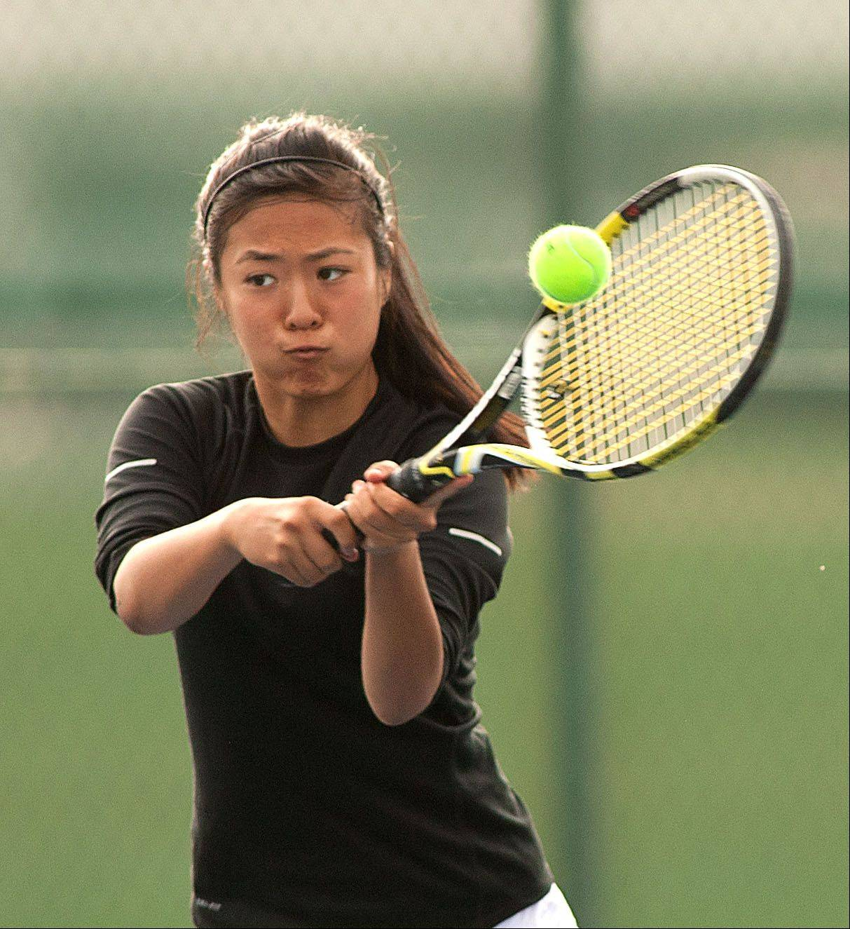 Naperville North doubles player Julia Li returns the ball during the DuPage Valley girls tennis finals at Naperville Central.