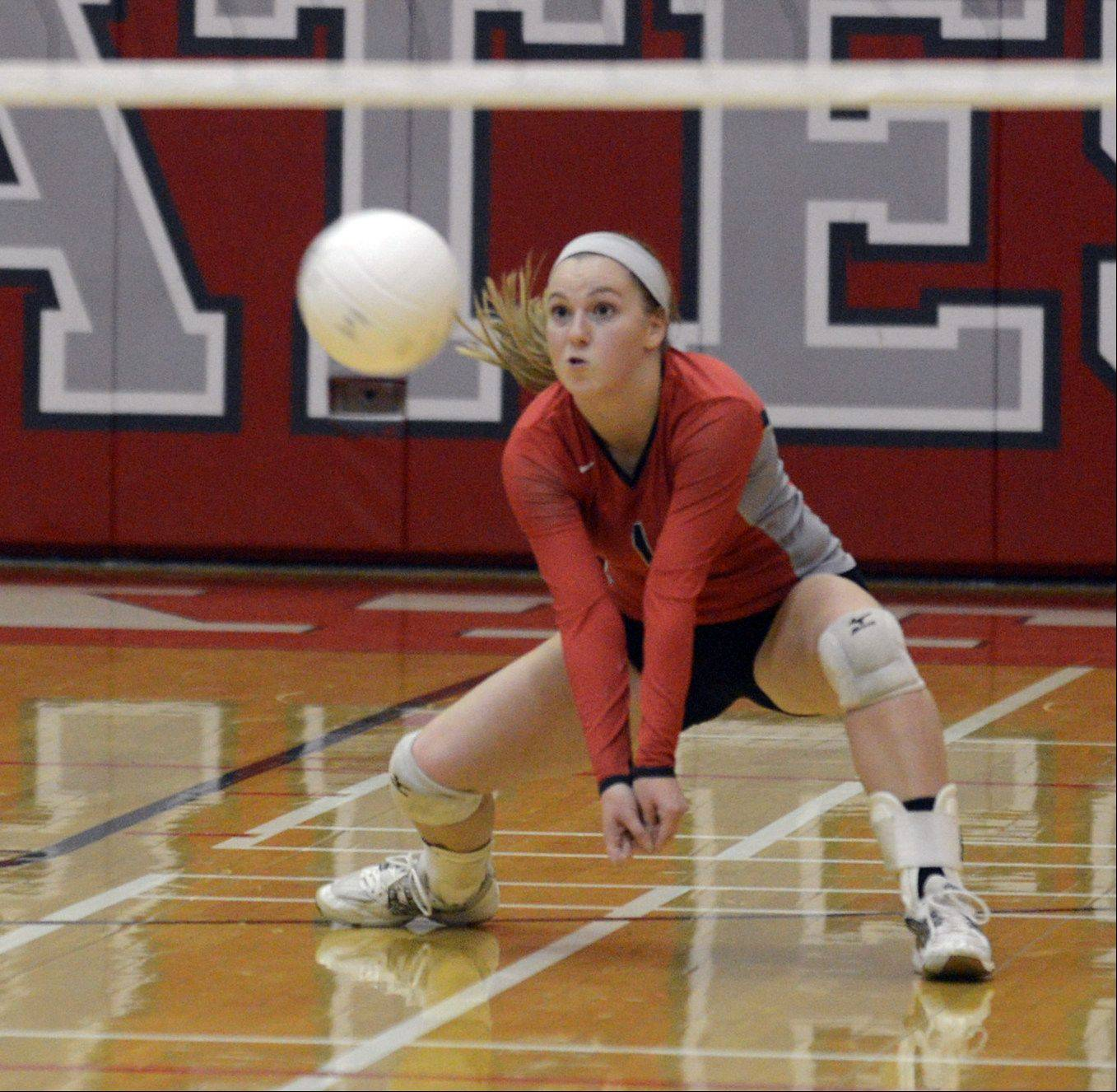 Palatine's Liz Keelty hits the ball during Monday's volleyball game against Stevenson in Palatine.