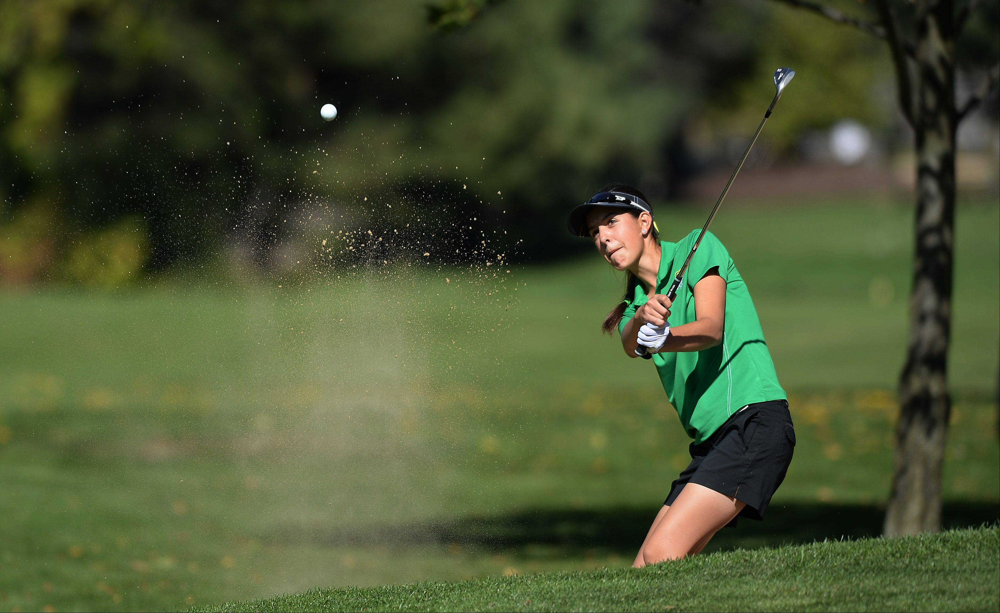 Stevenson's Nicole Marquardt blasts out of the bunker during Wednesday's girls golf regional at Mt. Prospect Golf Club.